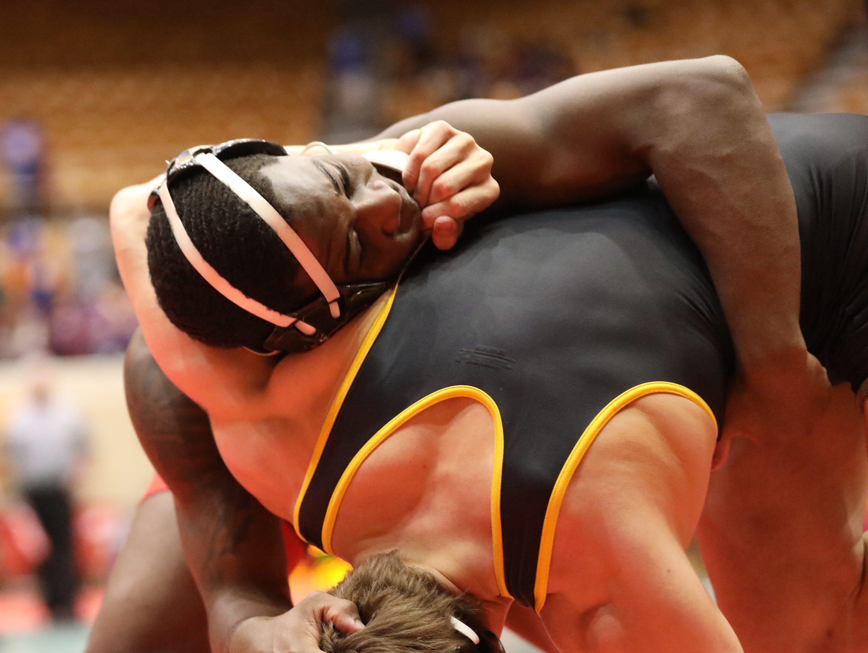 La Salle wrestler Elan Heard battles  Lakewood St. Edward wrestler Sam Dover during the state dual wrestling meet in Columbus, Ohio, Sunday, Feb. 10, 2019.