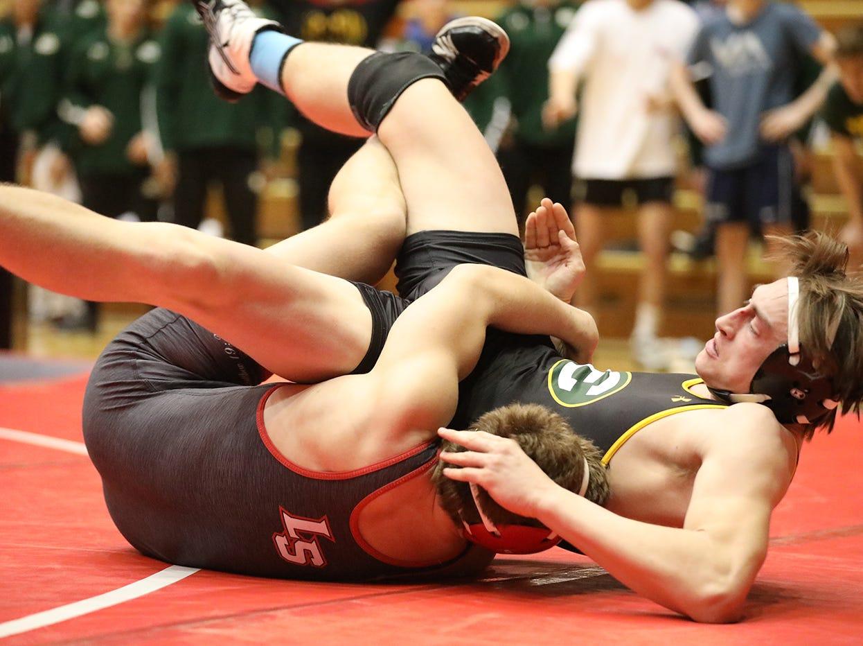 Lakewood St. Edward wrestler Nickolas Lisco battles La Salle wrestler Micheal Baker during the state dual meet in Columbus, Ohio, Sunday, Feb. 10, 2019.