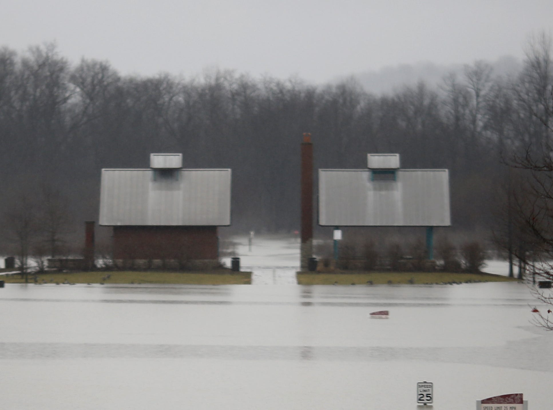 Flood waters cover the parking lots and soccer fields at Otto Armleder Memorial Park & Recreation Complex in the Linwood neighborhood of Cincinnati on Monday, Feb. 11, 2019.