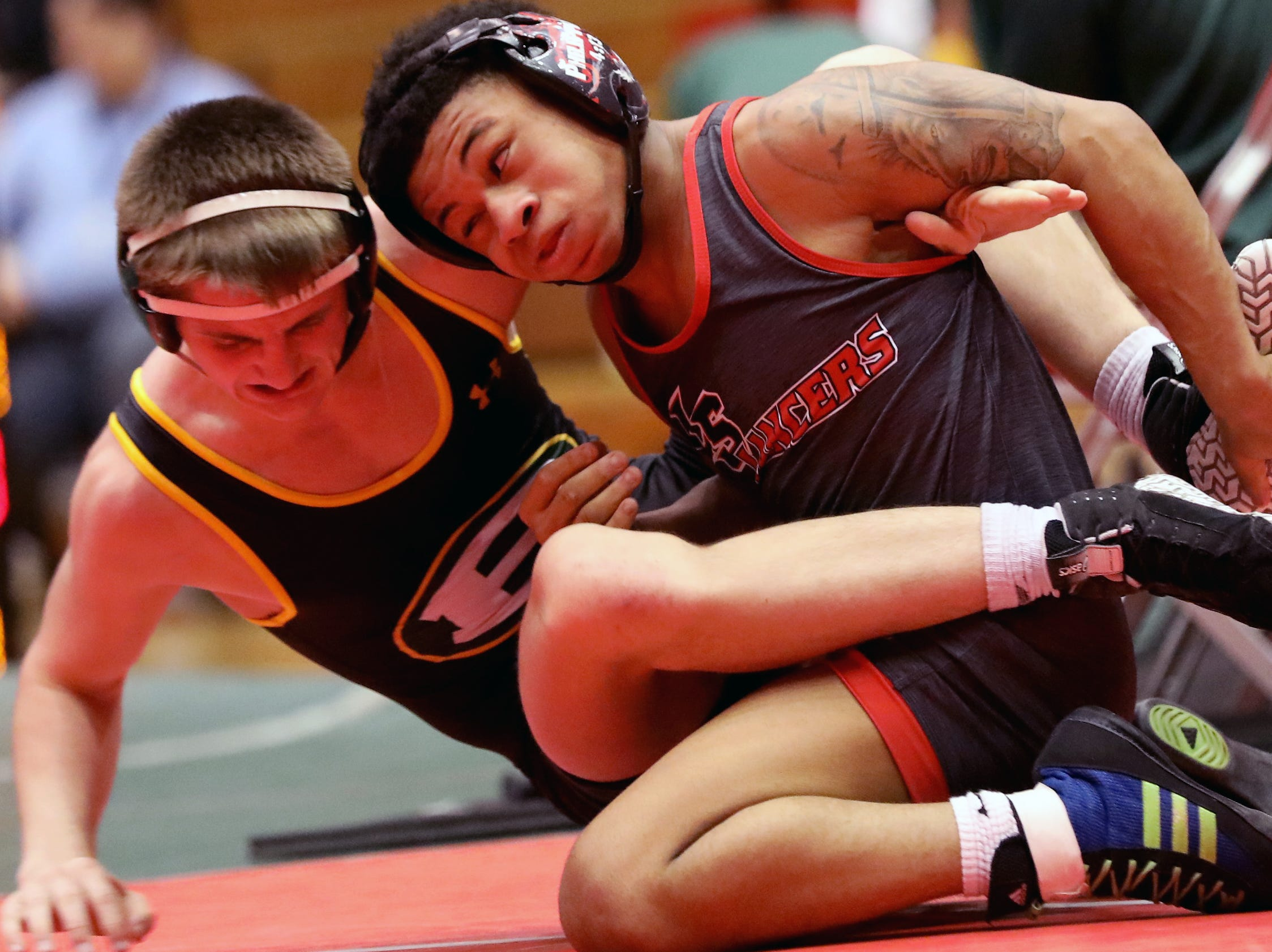 La Salle wrestler Casey Wiles battles  Lakewood St. Edward wrestler Scot Richter during the state dual wrestling meet in Columbus, Ohio, Sunday, Feb. 10, 2019.