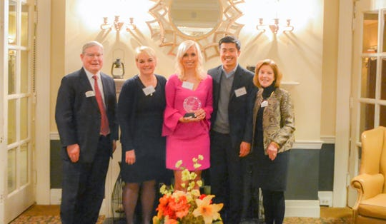 From left: Steve Simendinger, Bayley Board Chair, family members Paula Jansen, Jackie Jansen Yi and James Yi with Adrienne Walsh, Bayley President/CEO.