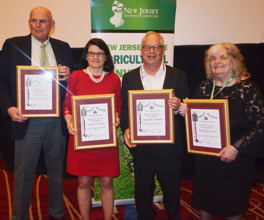 (Left to right) John Dreyer, Nancy Trivette, Ray Samulis, and Joy Ricker, accepting their Distinguished Service to Agriculture Awards.
