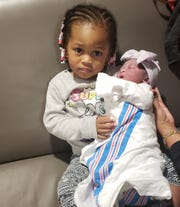 Big Sister Savannah Dawson, 2, holds her new sibling, Bria Belle Dawson who arrived in a hurry at their Dunellen home on Jan. 31.