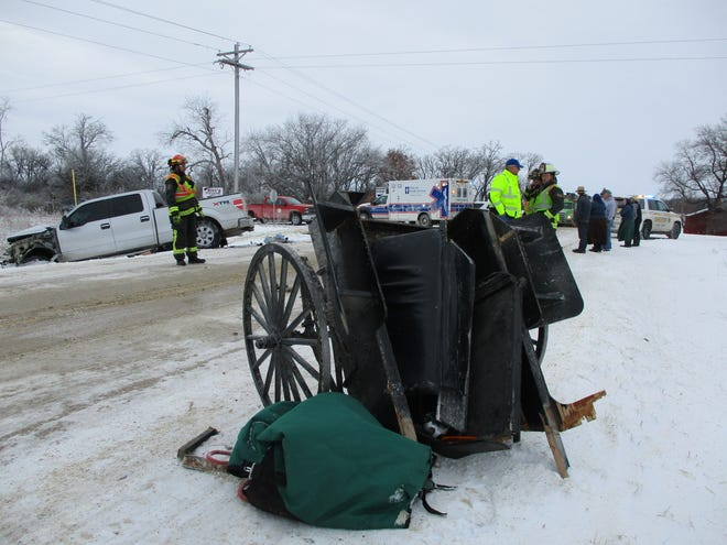 A buggy is overturned after a truck hit a horse and buggy on Saturday, Feb. 11, 2019, in Cresco, Ia.