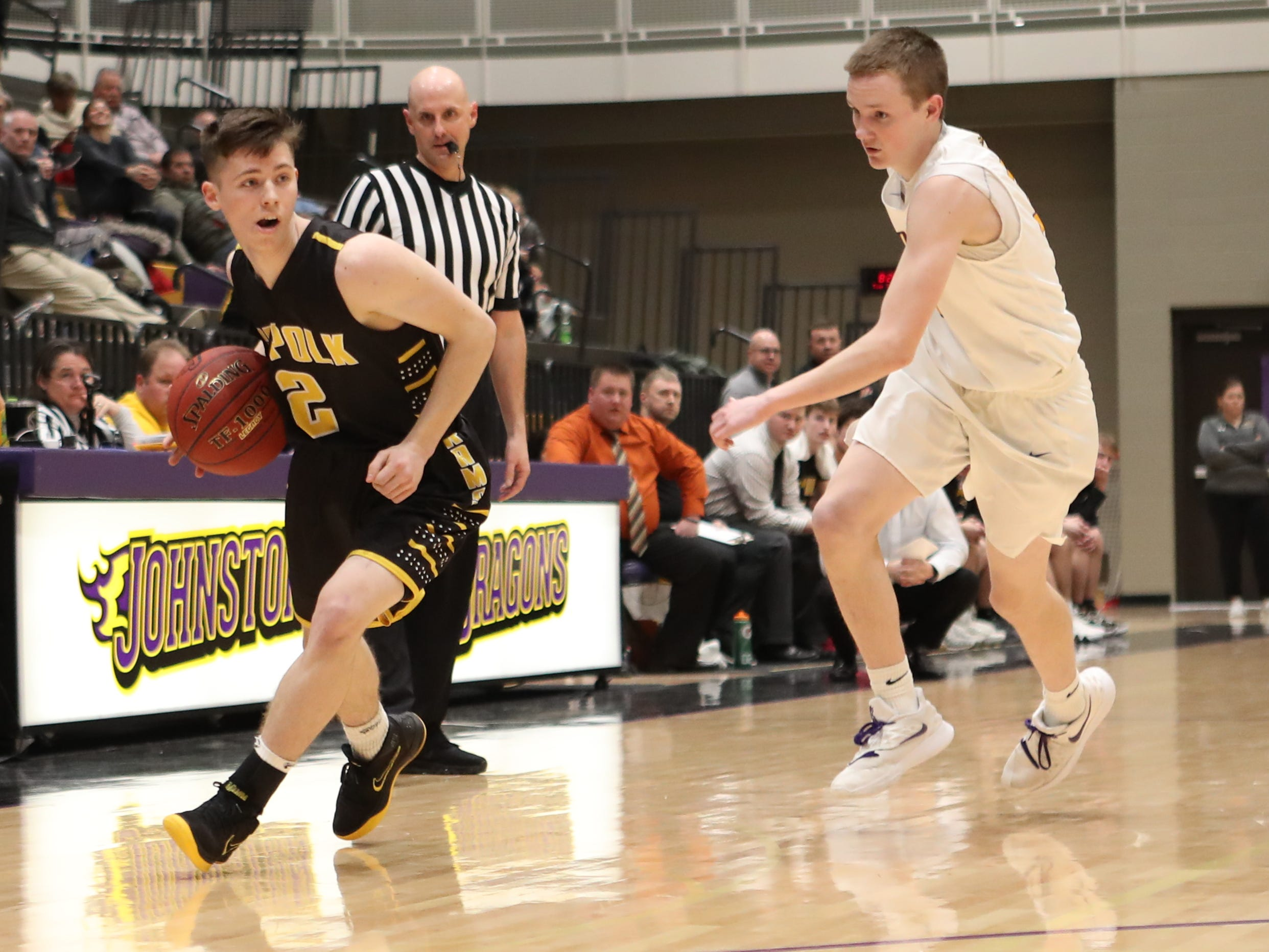 Southeast Polk's Eli Christiansen (2) beats the Dragons' defense down the court Feb. 5 at Johnston High School. Johnston won the game 51-44.