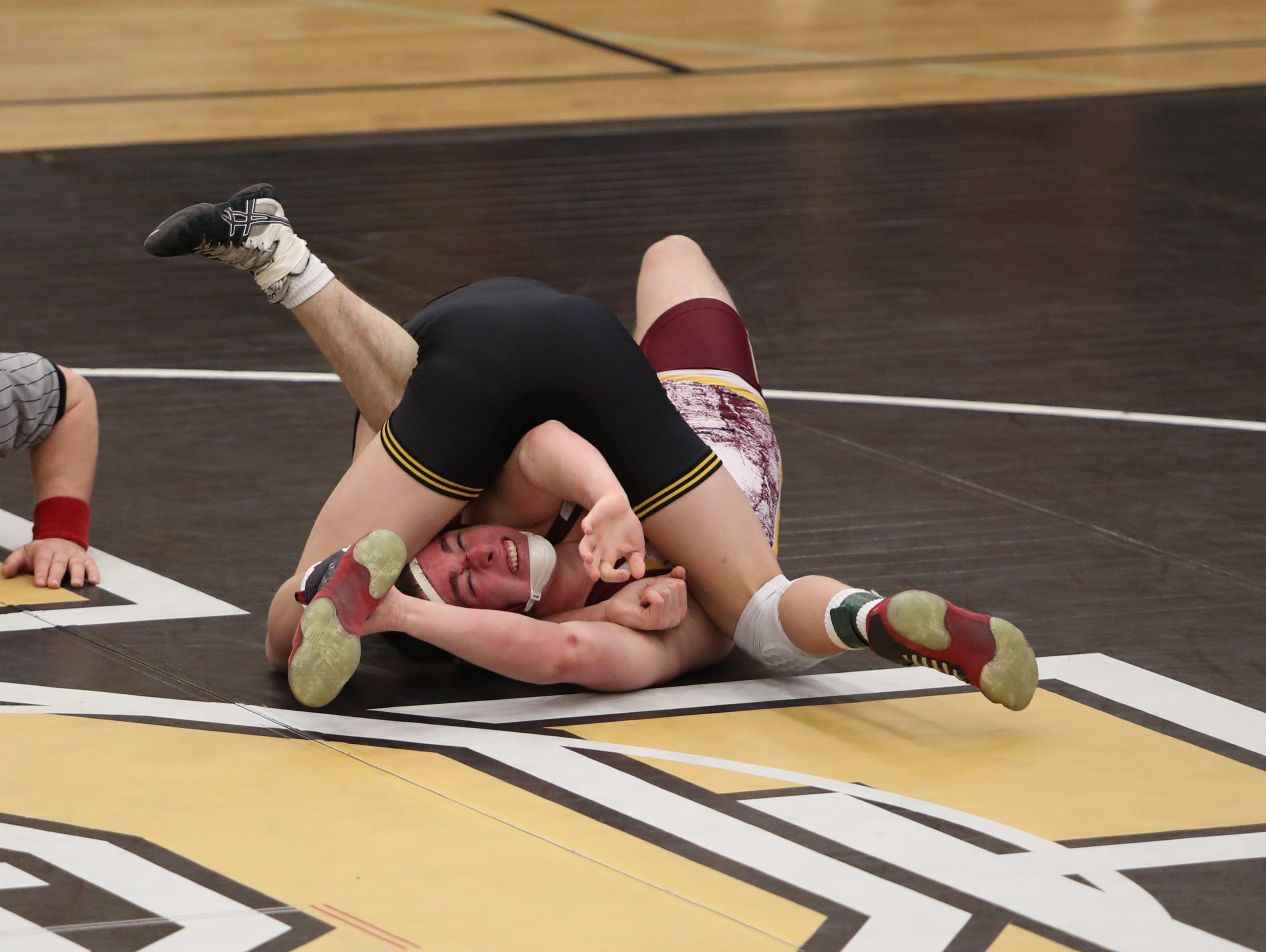 Southeast Polk's Cade DeVos pins Ankeny's Mo Watson in a 160-pound match in 1:36. Southeast Polk defeated Ankeny 57-17 in a regional dual Feb. 6 at Southeast Polk.