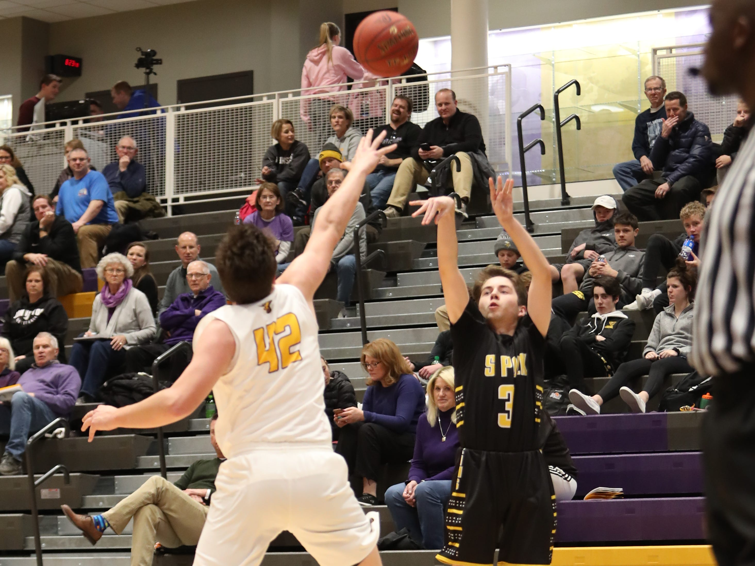 Southeast Polk's Kaleb Krier (3) shoots over the Johnston defense Feb. 5 at Johnston High School. Johnston won the game 51-44.