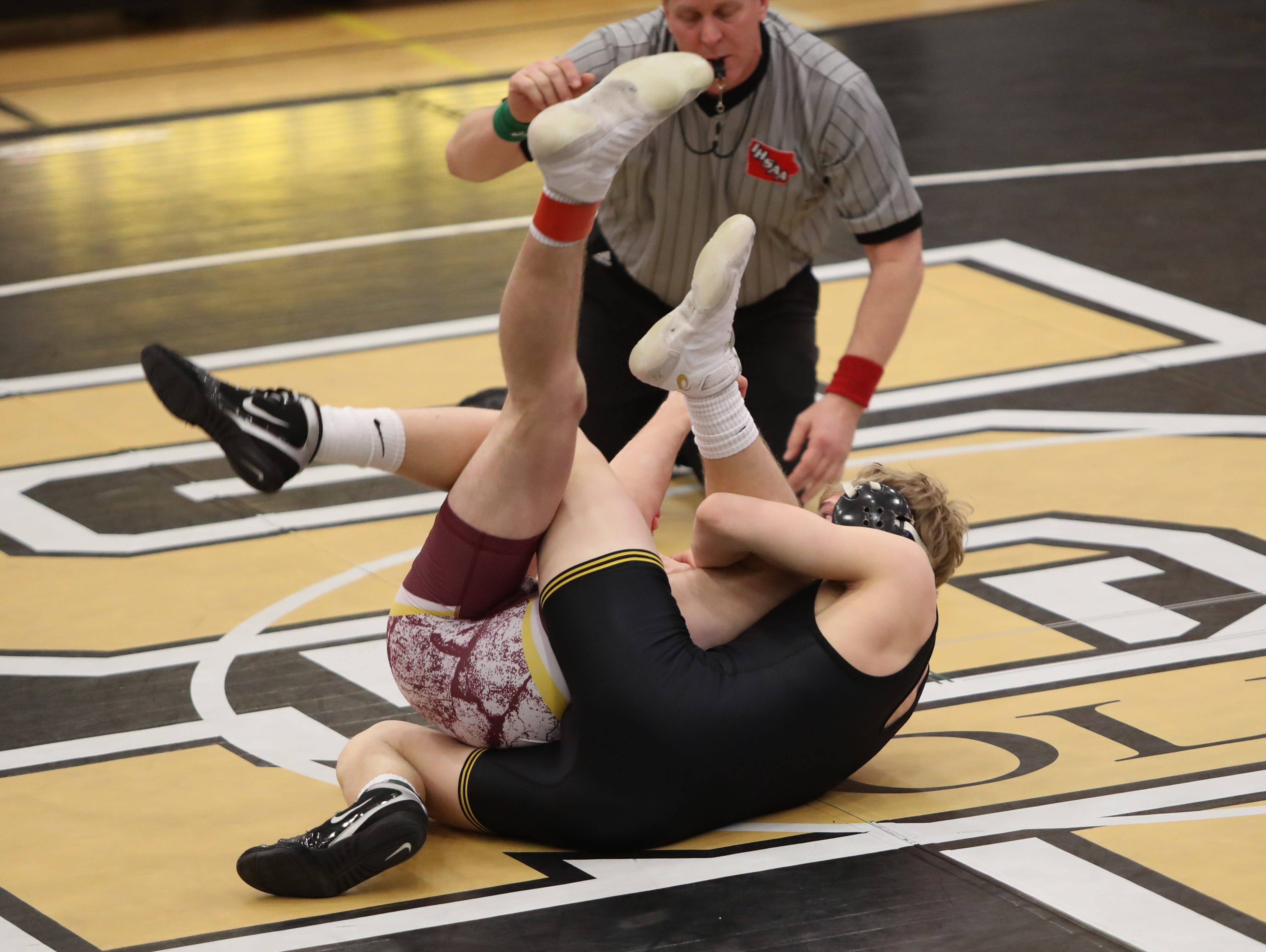 Southeast Polk's Lance Runyon (152 pounds) pins Ankeny's Daniel Rose in 42 seconds. Southeast Polk defeated Ankeny 57-17 in a Class 3A regional dual Feb. 6 at Southeast Polk.