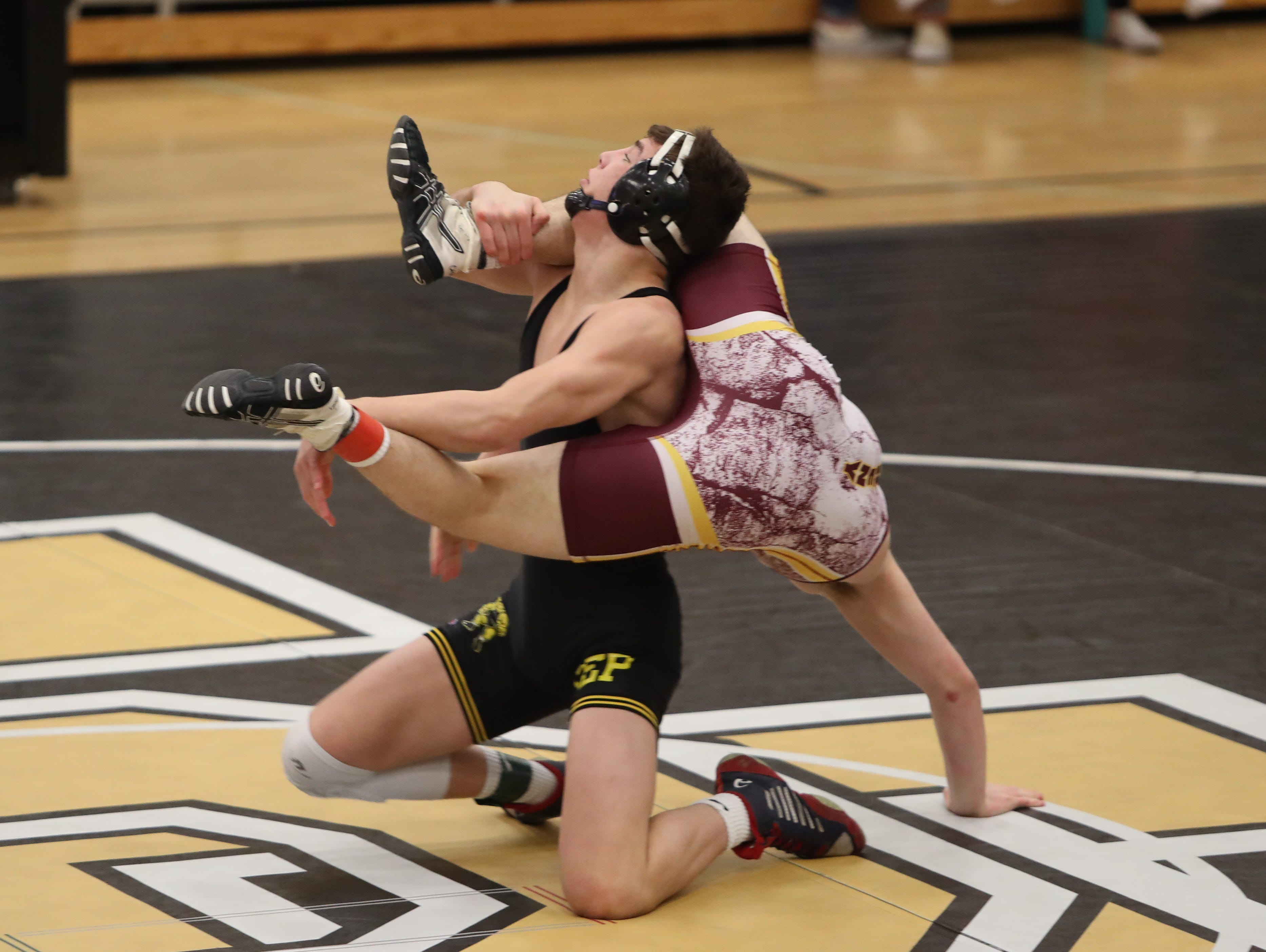 Southeast Polk's Cade DeVos controls the legs of Ankeny's Mo Watson at 160 pounds. DeVos won by fall in 1:36. Southeast Polk defeated Ankeny 57-17 in a Class 3A regional dual Feb. 6 at Southeast Polk.