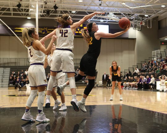 Southeast Polk's Maggie McGraw (32) shoots Feb. 5 in a game against No. 1 Johnston at Johnston High School. The Dragons won the game 89-67. McGraw had 23 points.