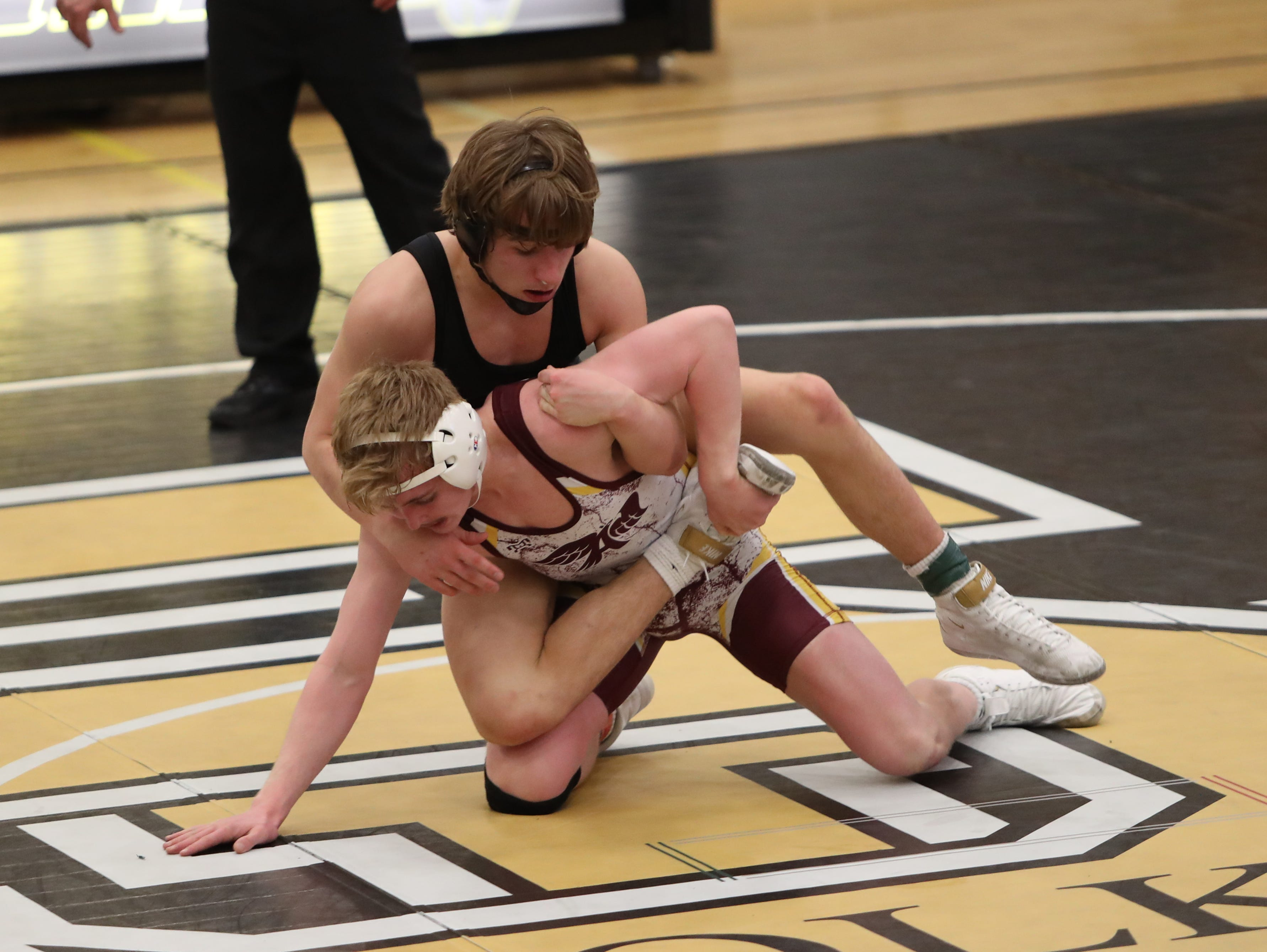 Southeast Polk's Carson Martinson controls Ankeny's Sam Kallem in a 132-pound match. Martinson won a 6-4 decision. Southeast Polk defeated Ankeny 57-17 in a Class 3A regional dual Feb. 6 at Southeast Polk.