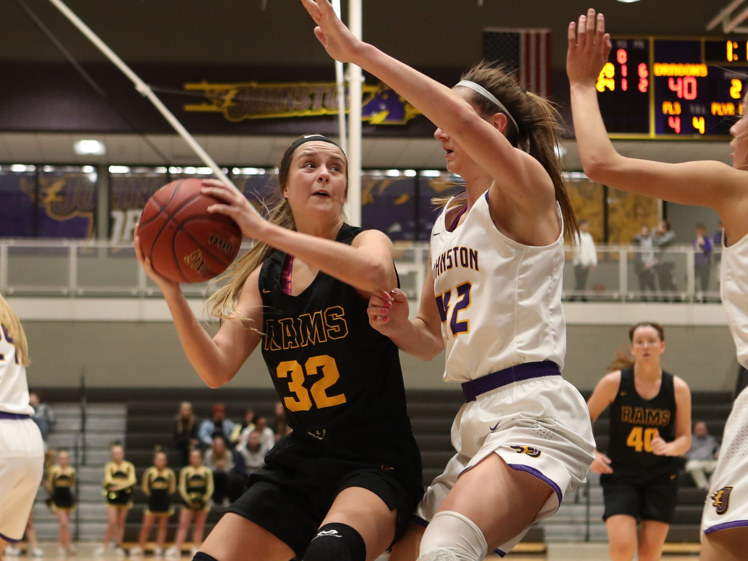 Southeast Polk's Maggie McGraw (32) looks to the basket Feb. 5 in a game against No. 1 Johnston at Johnston High School. The Dragons won the game 89-67. McGraw had 23 points.