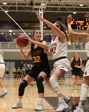 Southeast Polk's Maggie McGraw (32) looks to the basket Feb. 5 in a game against No. 1 Johnston at Johnston High School. McGraw led the Rams with 24 points in a 66-30 win against Marshalltown in a regional semifinal Saturday.