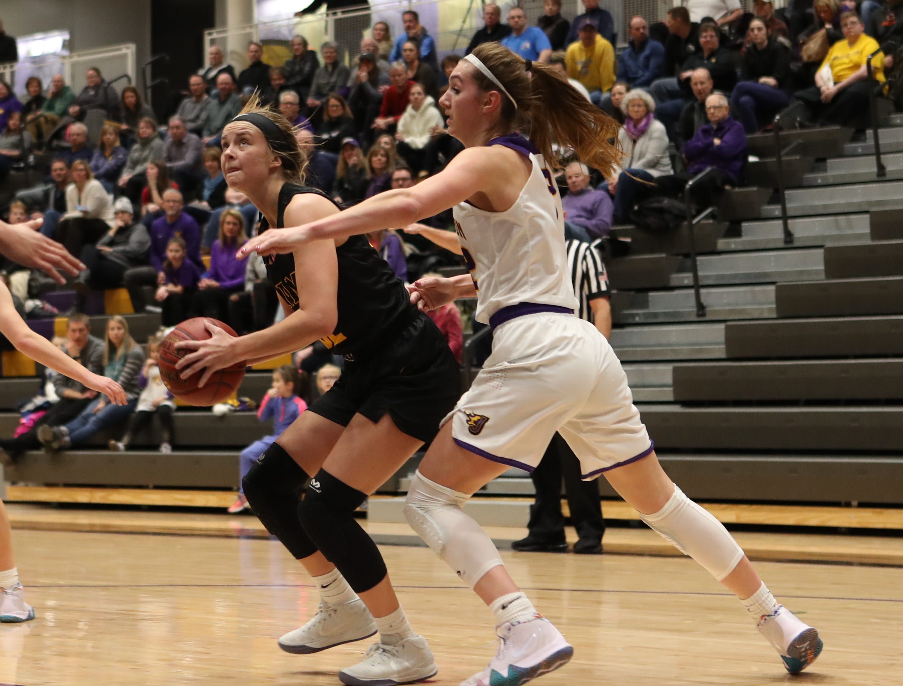 Southeast Polk's Maggie McGraw (32) drives to the basket Feb. 5 in a game against No. 1 Johnston at Johnston High School. The Dragons won the game 89-67. McGraw had 23 points.