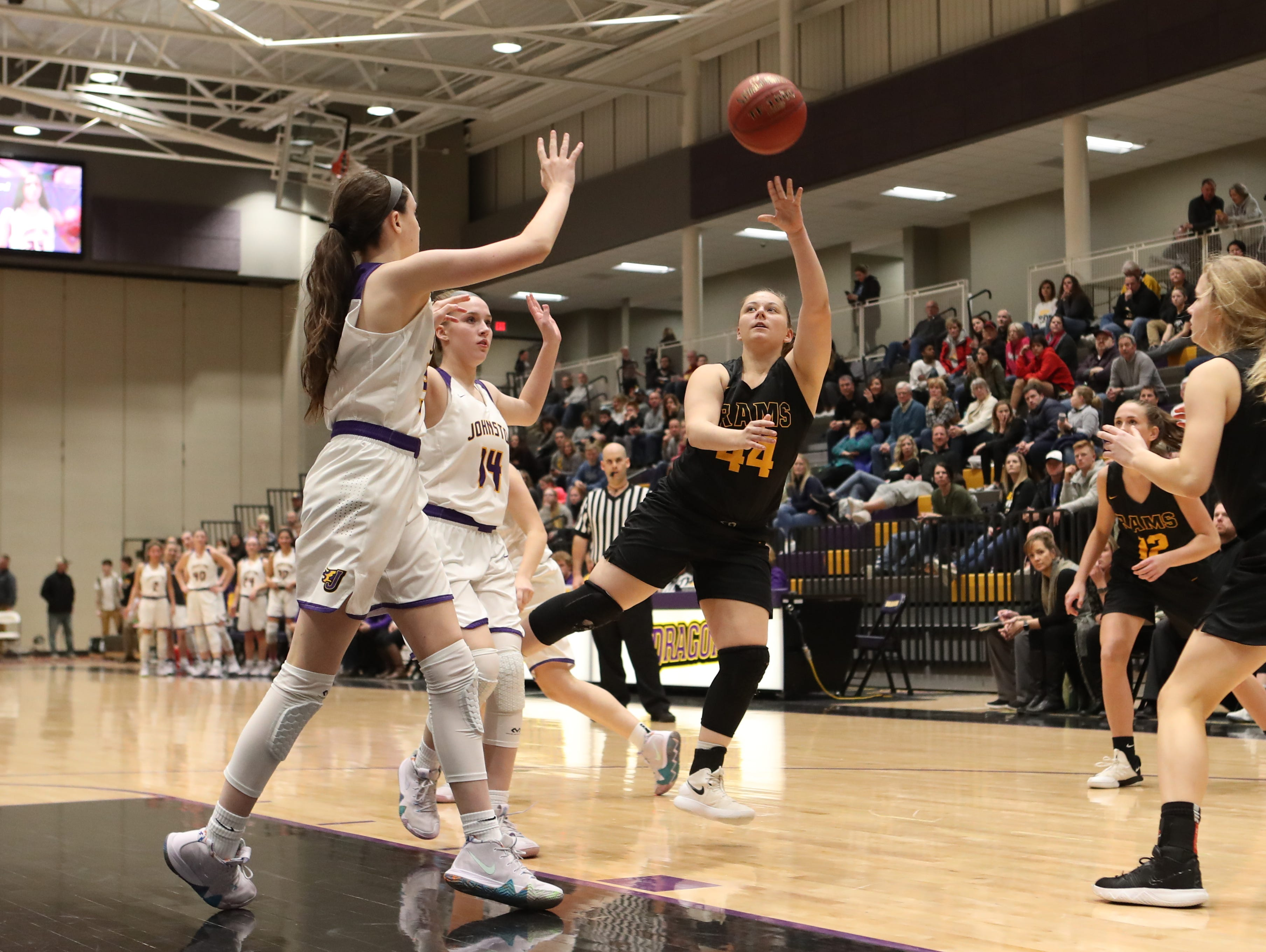 Southeast Polk's Kadence Williams (44) shoots from the outside Feb. 5 in a game against No. 1 Johnston at Johnston High School. The Dragons won the game 89-67.