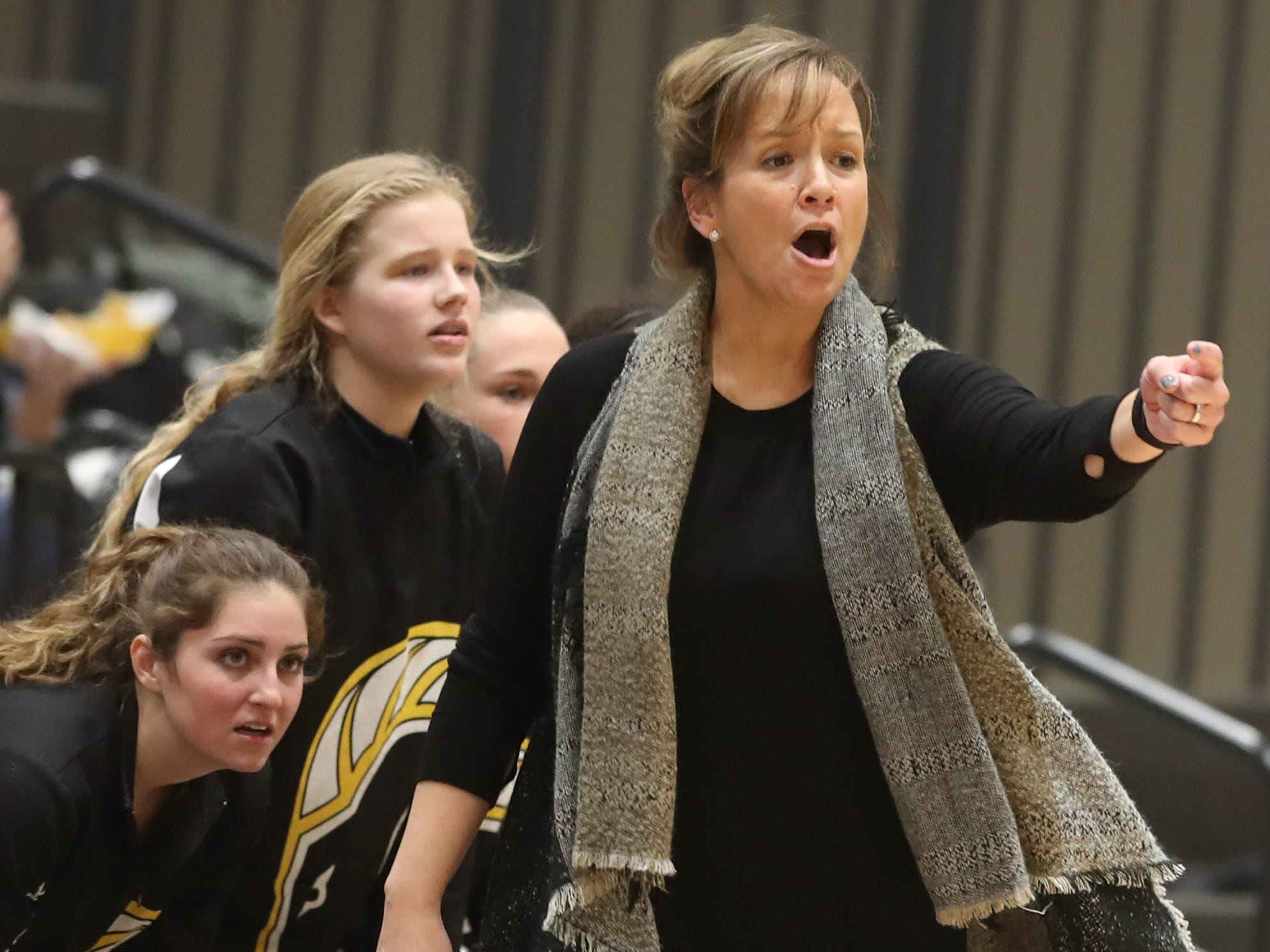 Southeast Polk coach Tracy Dailey shoots from the sideline Feb. 5 in a game against No. 1 Johnston at Johnston High School. The Dragons won the game 89-67.