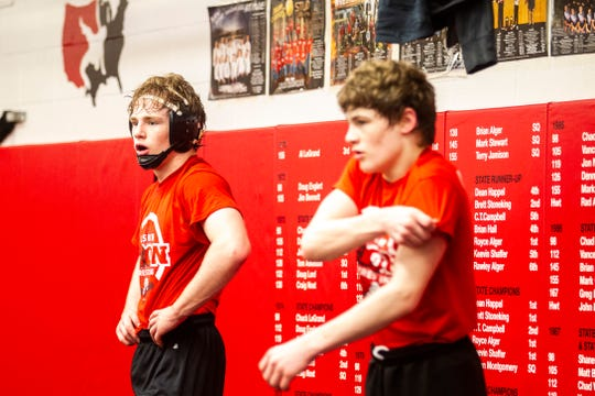 Cael, left, and Quincy Happel rest during a wrestling practice on Friday, Feb. 8, 2019 in Lisbon, Iowa. Cael is a two-time Class 1A state champion.
