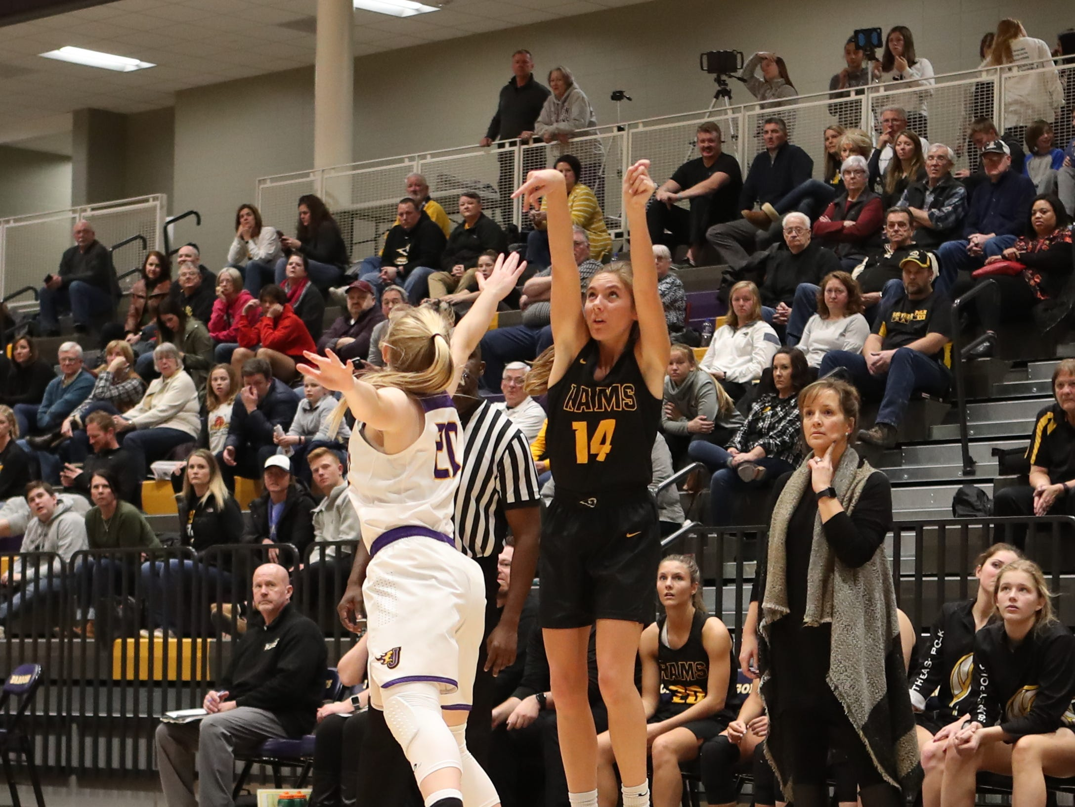 Southeast Polk's Jessica Stuart (14) shoots a 3-pointer Feb. 5 in a game against No. 1 Johnston at Johnston High School. The Dragons won the game 89-67.