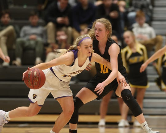 Southeast Polk's Grace Larkins (10) defends a Johnston player Feb. 5 in a game at Johnston High School. The Dragons won the game 89-67.
