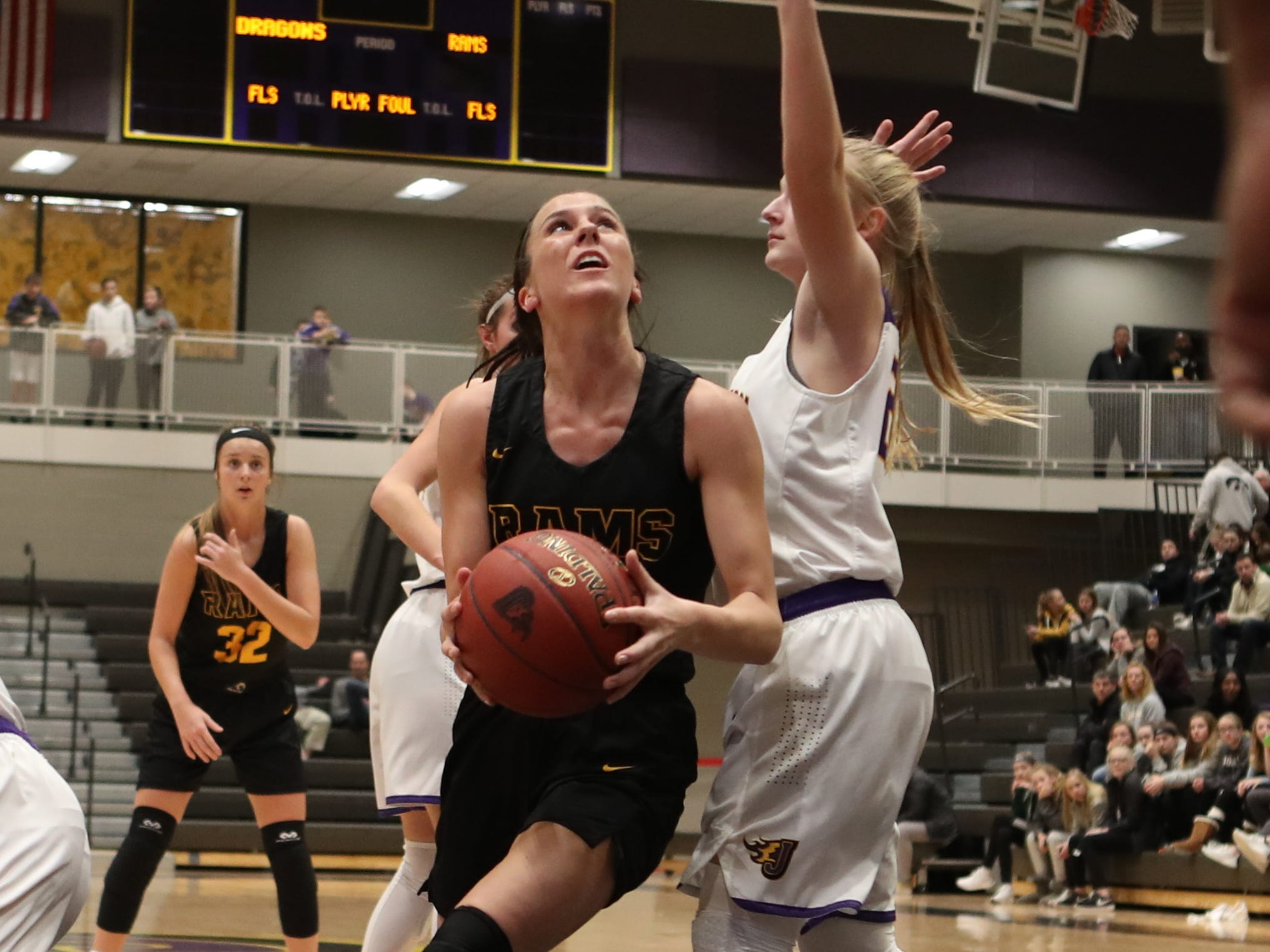Southeast Polk's Liza Sutten (2) drives to the basket Feb. 5 in a game against No. 1 Johnston at Johnston High School. The Dragons won the game 89-67.