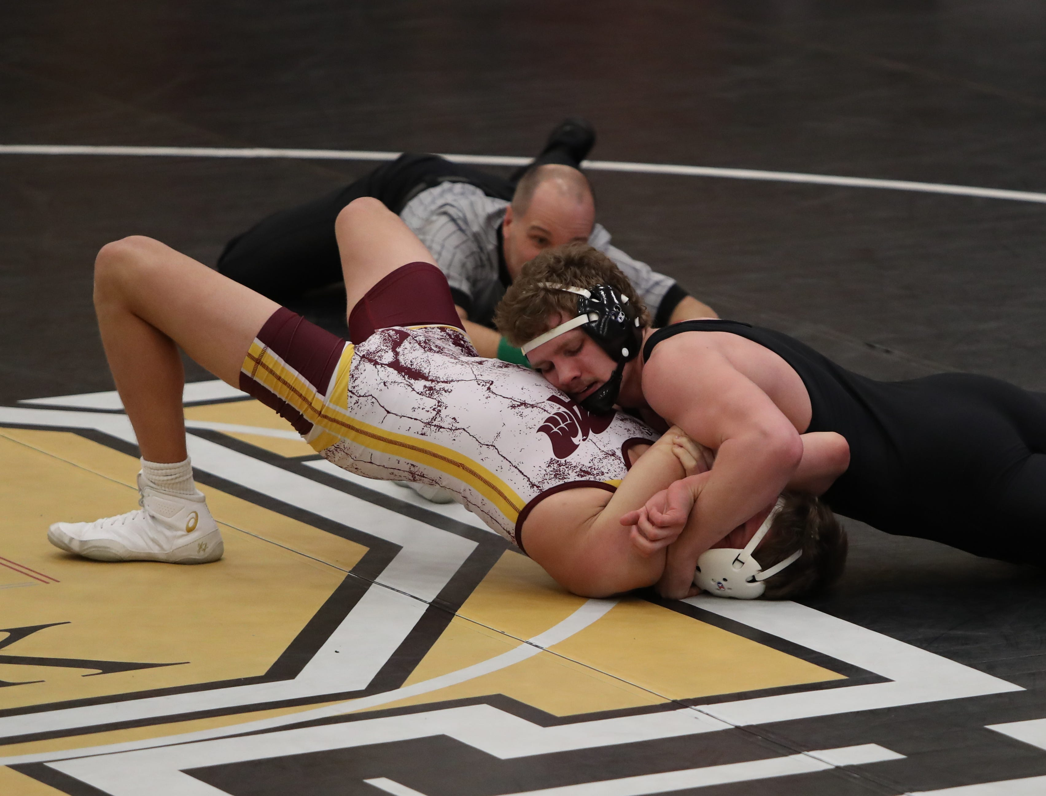 Southeast Polk's Justin Brindley pins Ankeny's Cole Pomrenke in 2:50 in a 182-pound match. Southeast Polk defeated Ankeny 57-17 in a Class 3A regional dual Feb. 6 at Southeast Polk.