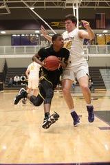 Southeast Polk's Malichai Williams drives to the basket against Johnston senior Peyton Williams on Feb. 5 at Johnston High School.