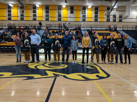 Southeast Polk honored four seniors Friday night before the Rams' final home game of the regular season. From left with their families are Liza Sutten, Ashlyn Naeve, Maggie McGraw and Sami Albertson.