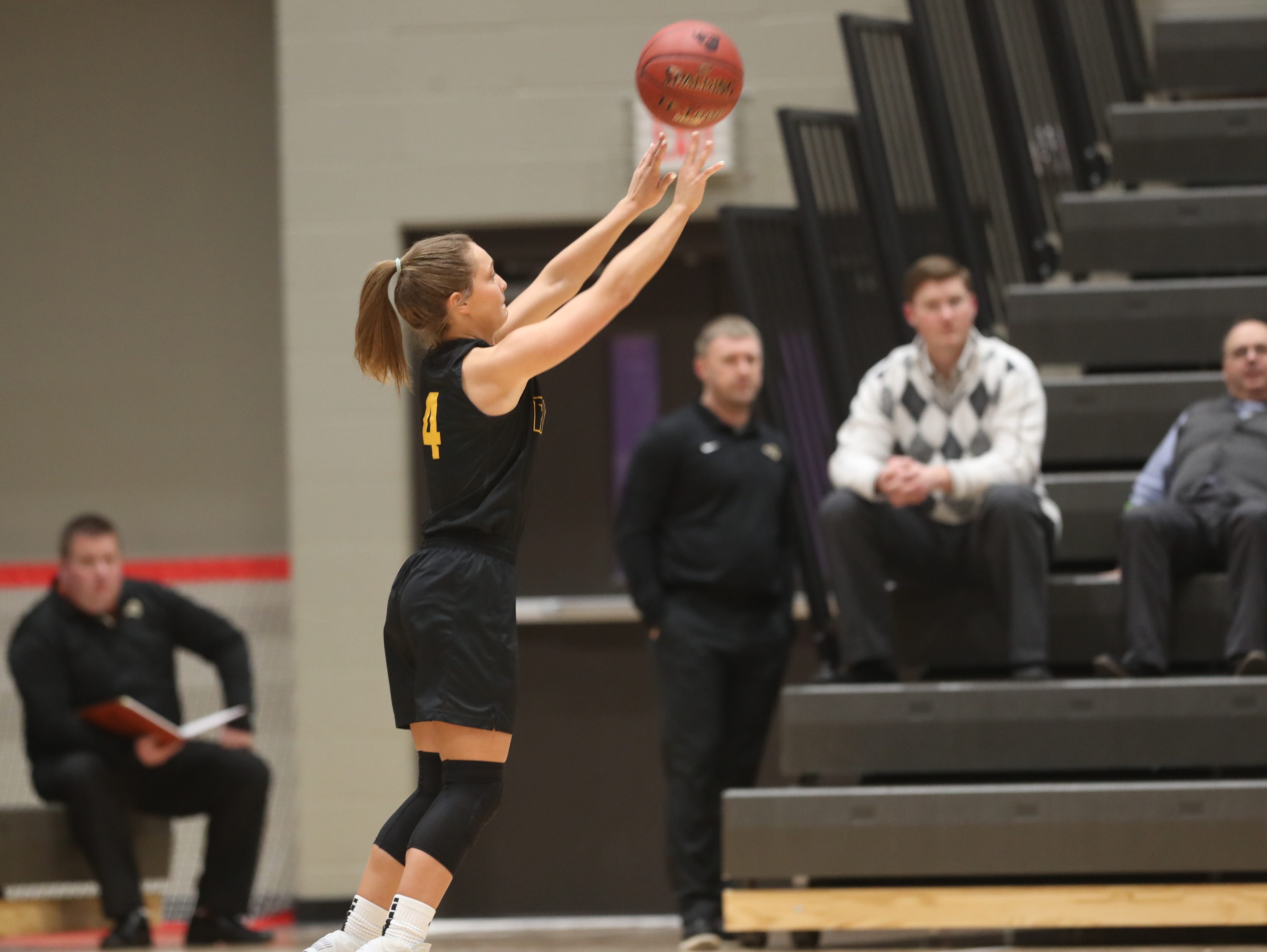 Southeast Polk's Jaycie Elliott (4) shoots from the outside Feb. 5 in a game against No. 1 Johnston at Johnston High School. The Dragons won the game 89-67.