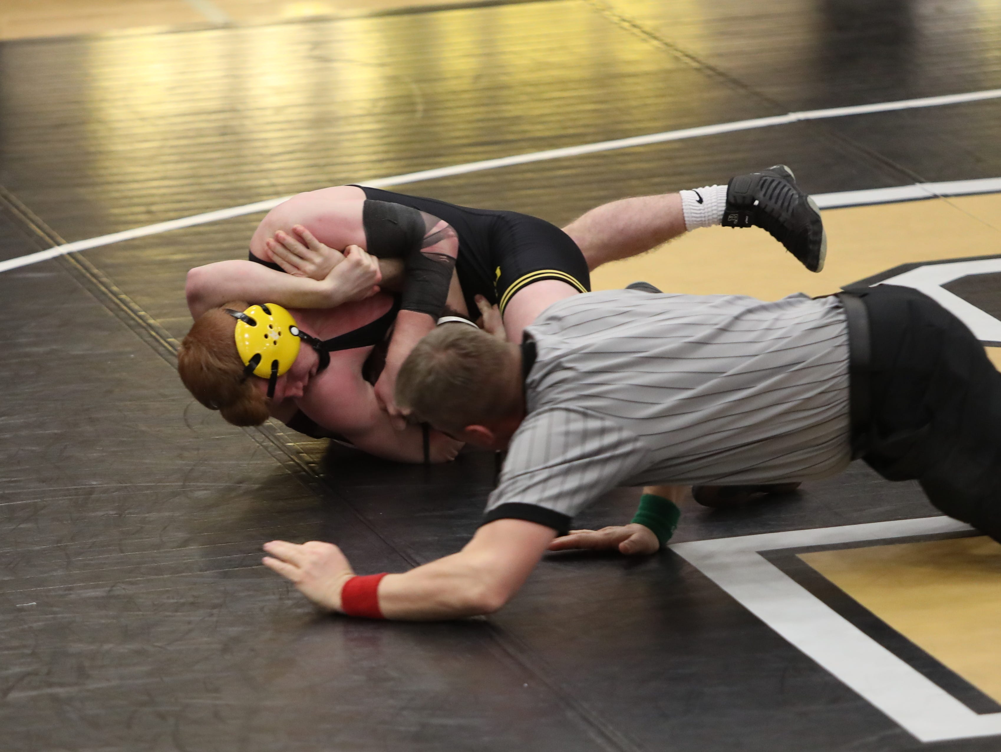 Southeast Polk's Ryan Strickland pins Ankeny's Wyatt Carl in their 145-pound match in 1:16. Southeast Polk defeated Ankeny 57-17 in a Class 3A regional dual Feb. 6 at Southeast Polk.