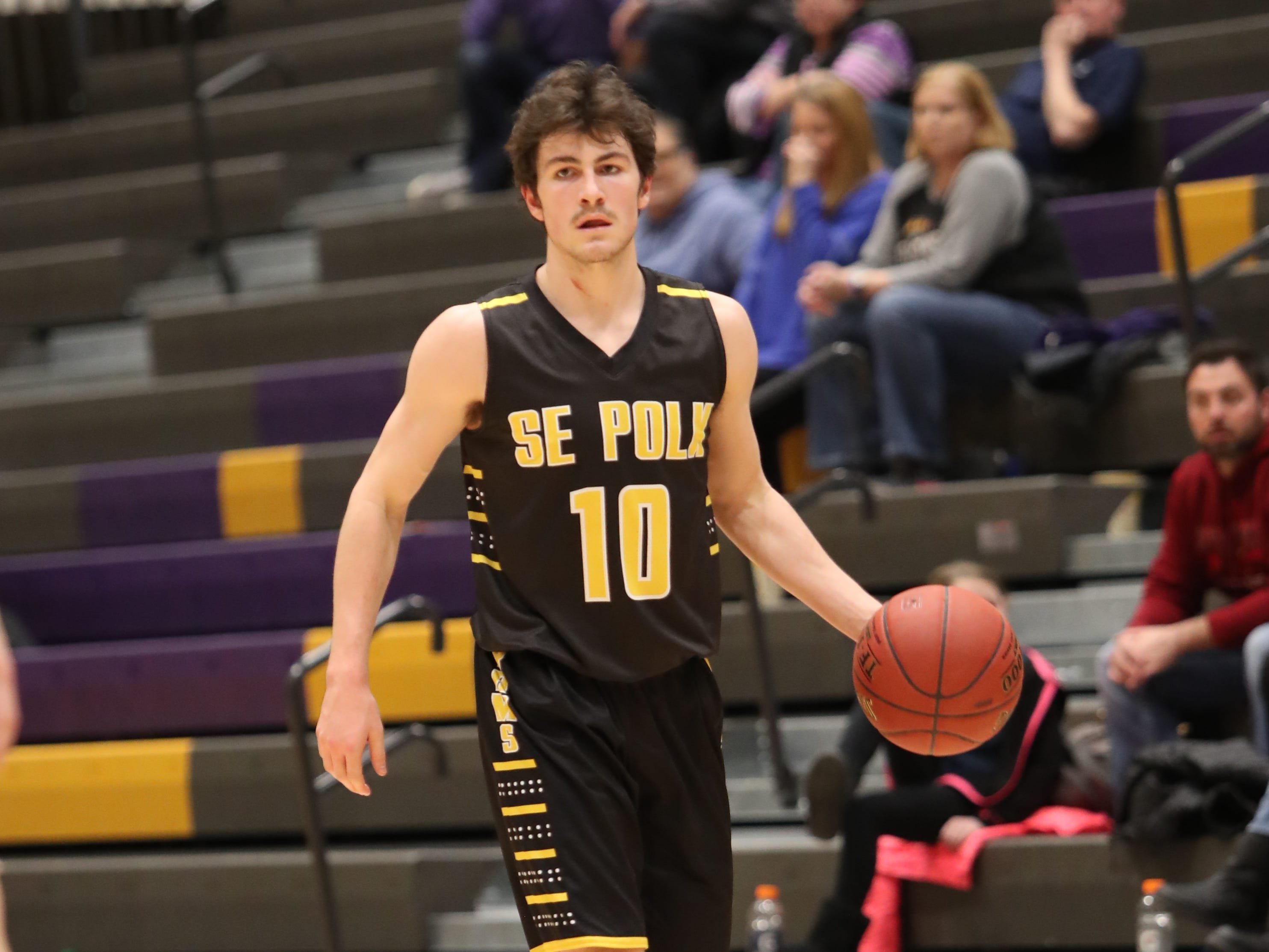 Southeast Polk's Daniel Hackbarth (10) brings the ball up the court Feb. 5 against the Dragons at Johnston High School. Johnston won the game 51-44.