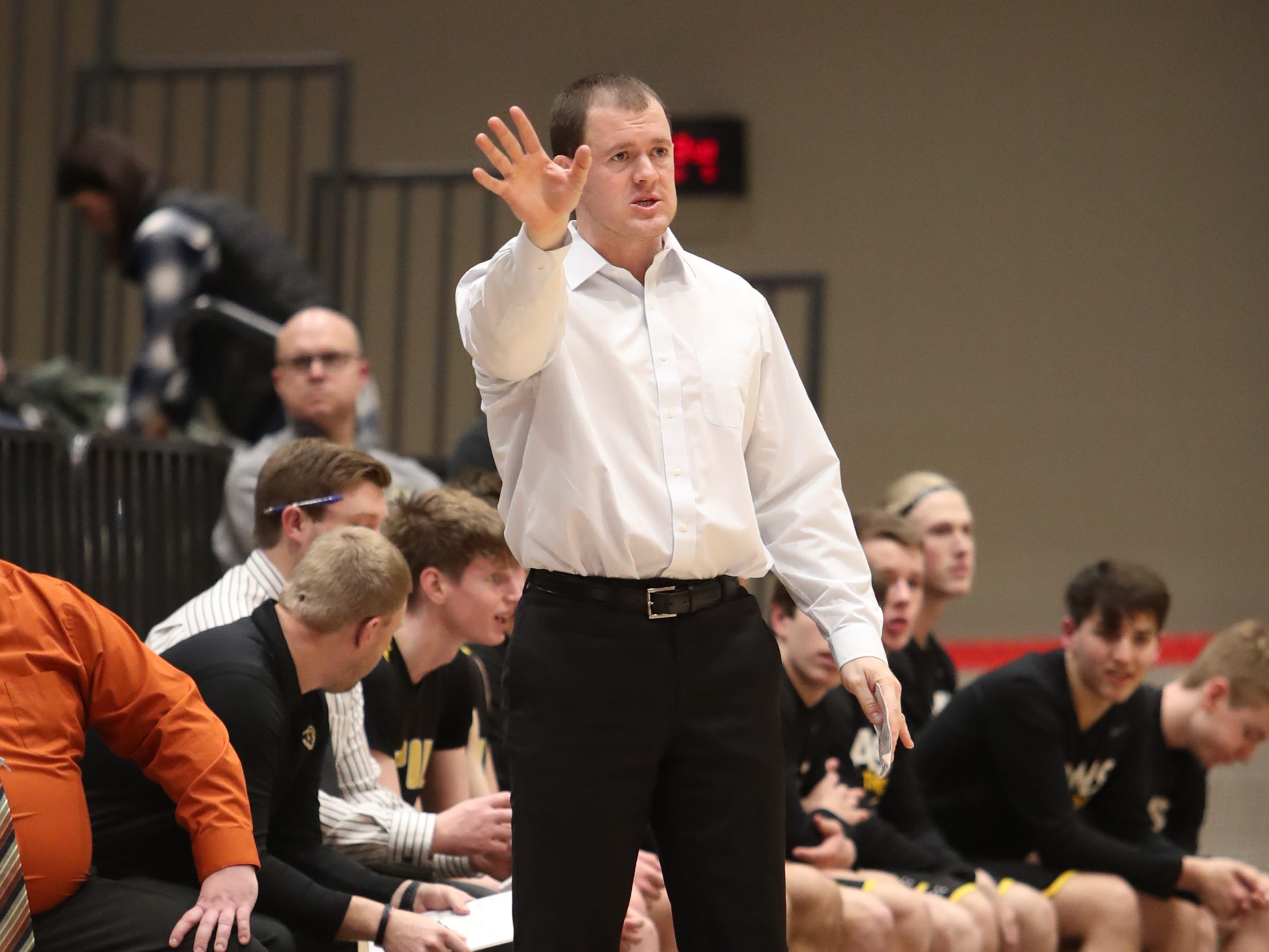 Southeast Polk coach Alan Jenkins talks to his team Feb. 5 during a game at Johnston High School. Johnston beat the Rams 51-44.