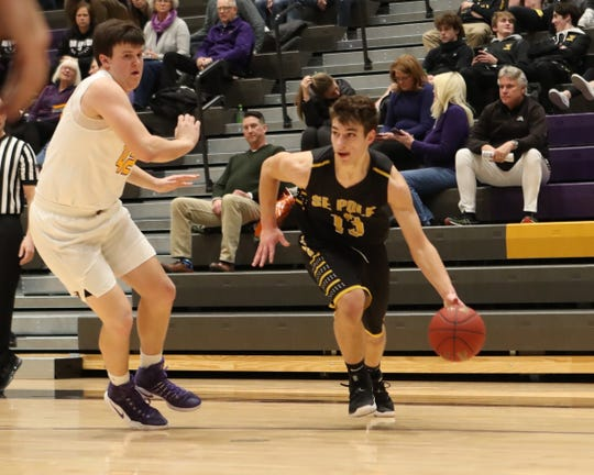 Southeast Polk's Dominic Caggiano (13) drives baseline against the Johnston defense Feb. 5 at Johnston High School. Johnston won the game 51-44.