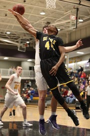 Southeast Polk's Malichai Williams (44) is fouled while shooting Feb. 5 in a game at Johnston High School. Johnston won the game 51-44.