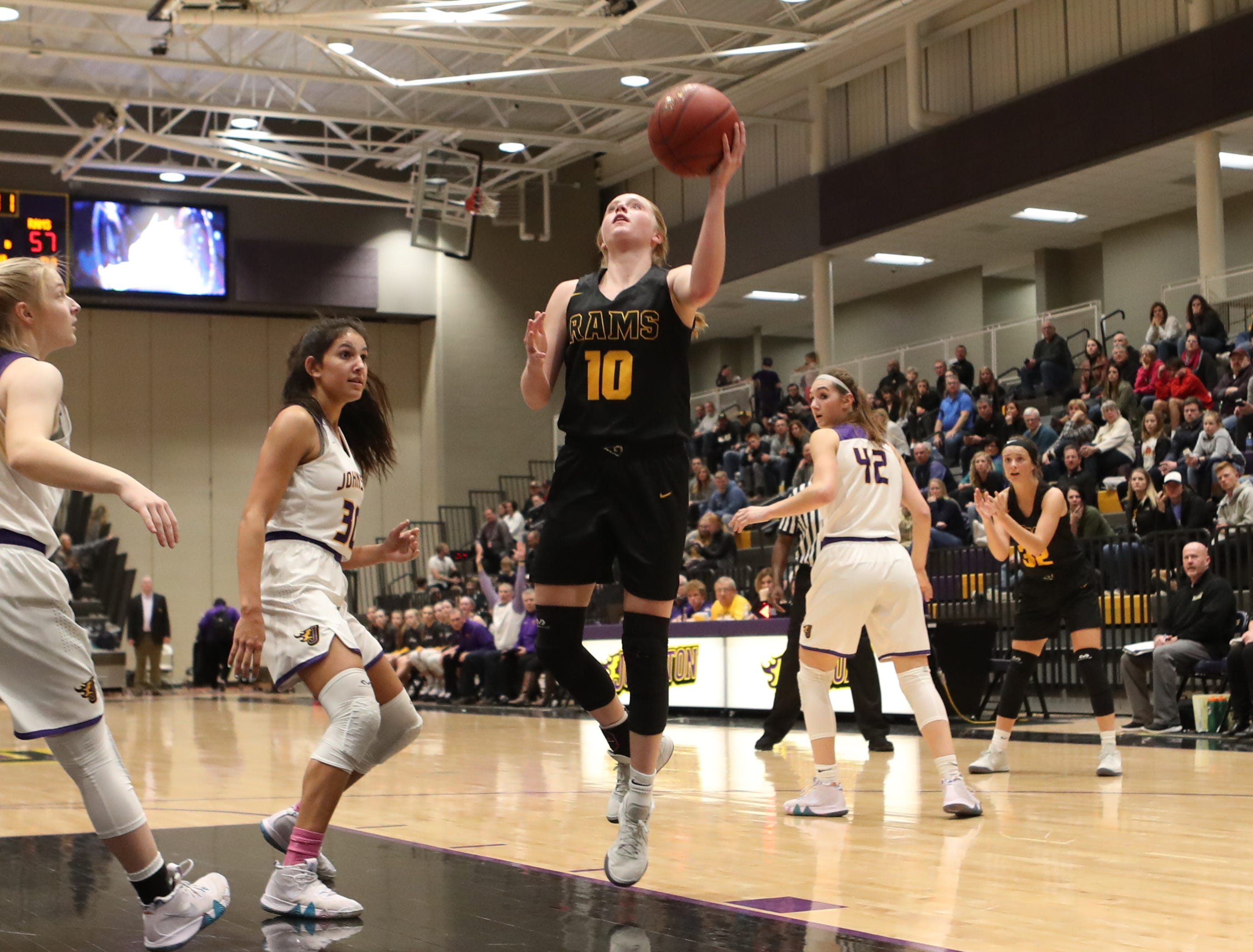 Southeast Polk's Grace Larkins (10) shoots Feb. 5 in a game against No. 1 Johnston at Johnston High School. The Dragons won the game 89-67. McGraw had 23 points.