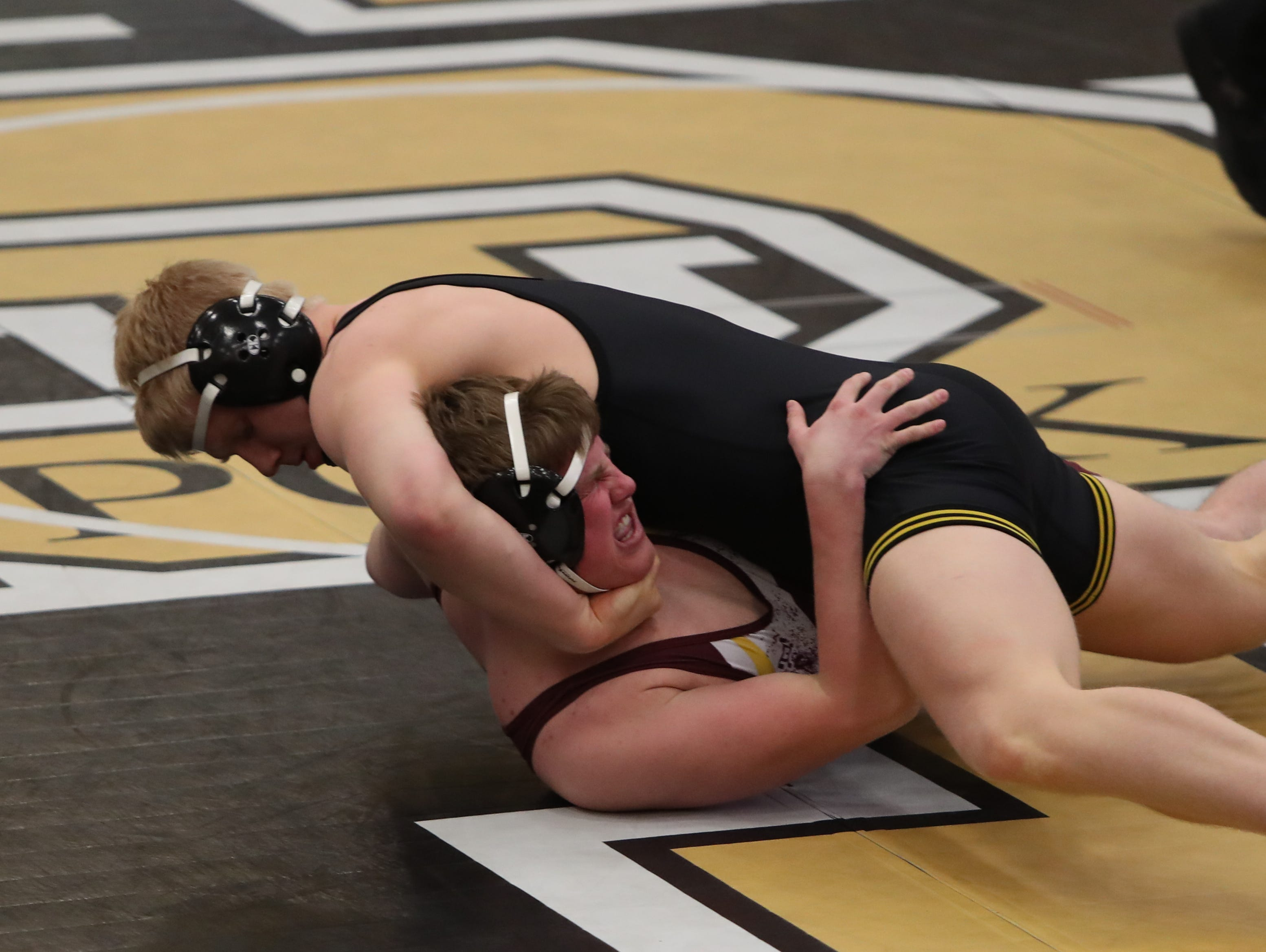 Southeast Polk's Gabe Christenson pins Ankeny's Cole Rathjen in 47 seconds at 195 pounds. Southeast Polk defeated Ankeny 57-17 in a Class 3A regional dual Feb. 6 at Southeast Polk.