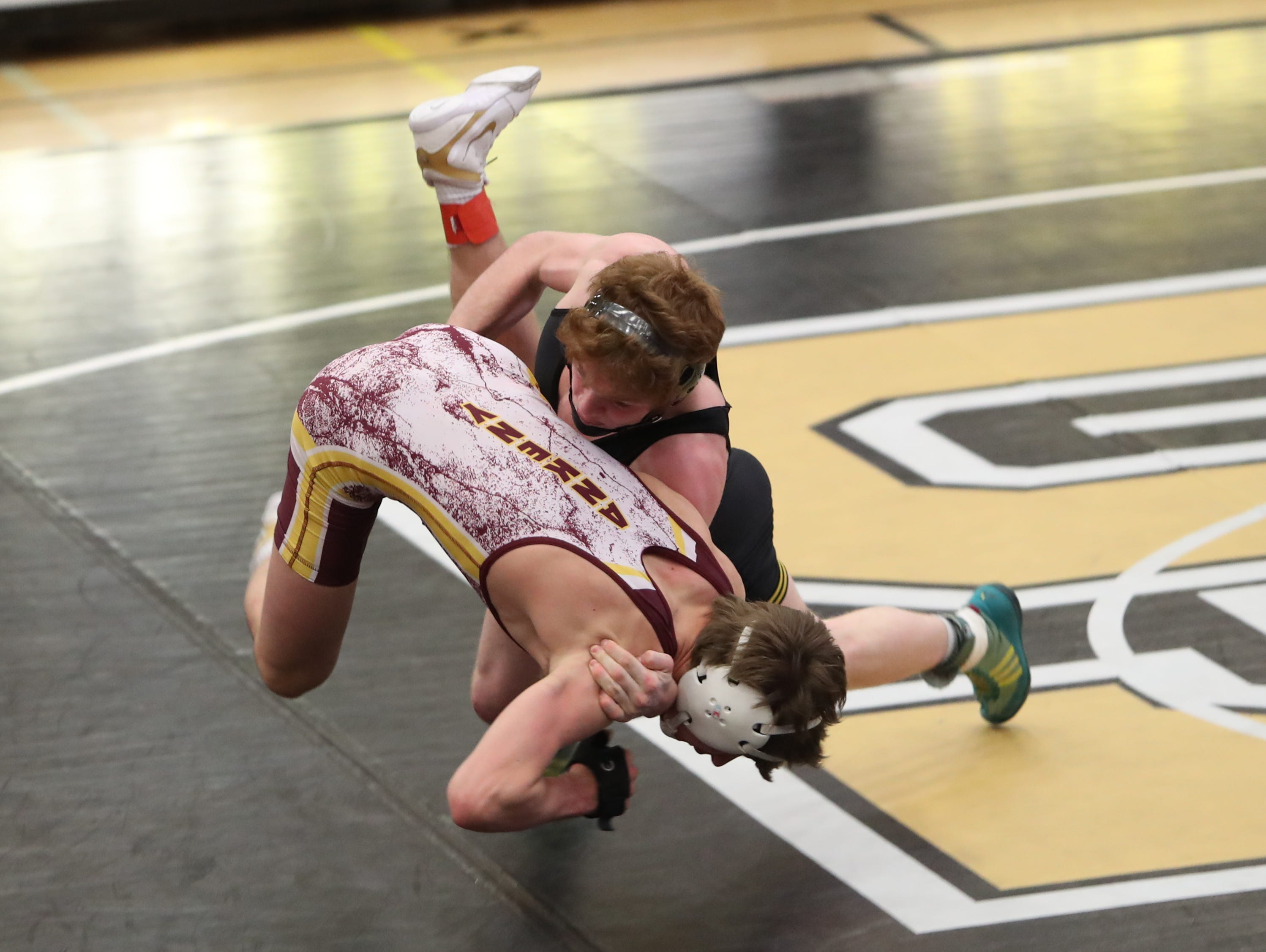 Southeast Polk's Nathan Marchand takes down Ankeny's Derek Anderson and gets the fall in their 138-pound match. Southeast Polk defeated Ankeny 57-17 in a Class 3A regional dual Feb. 6 at Southeast Polk.