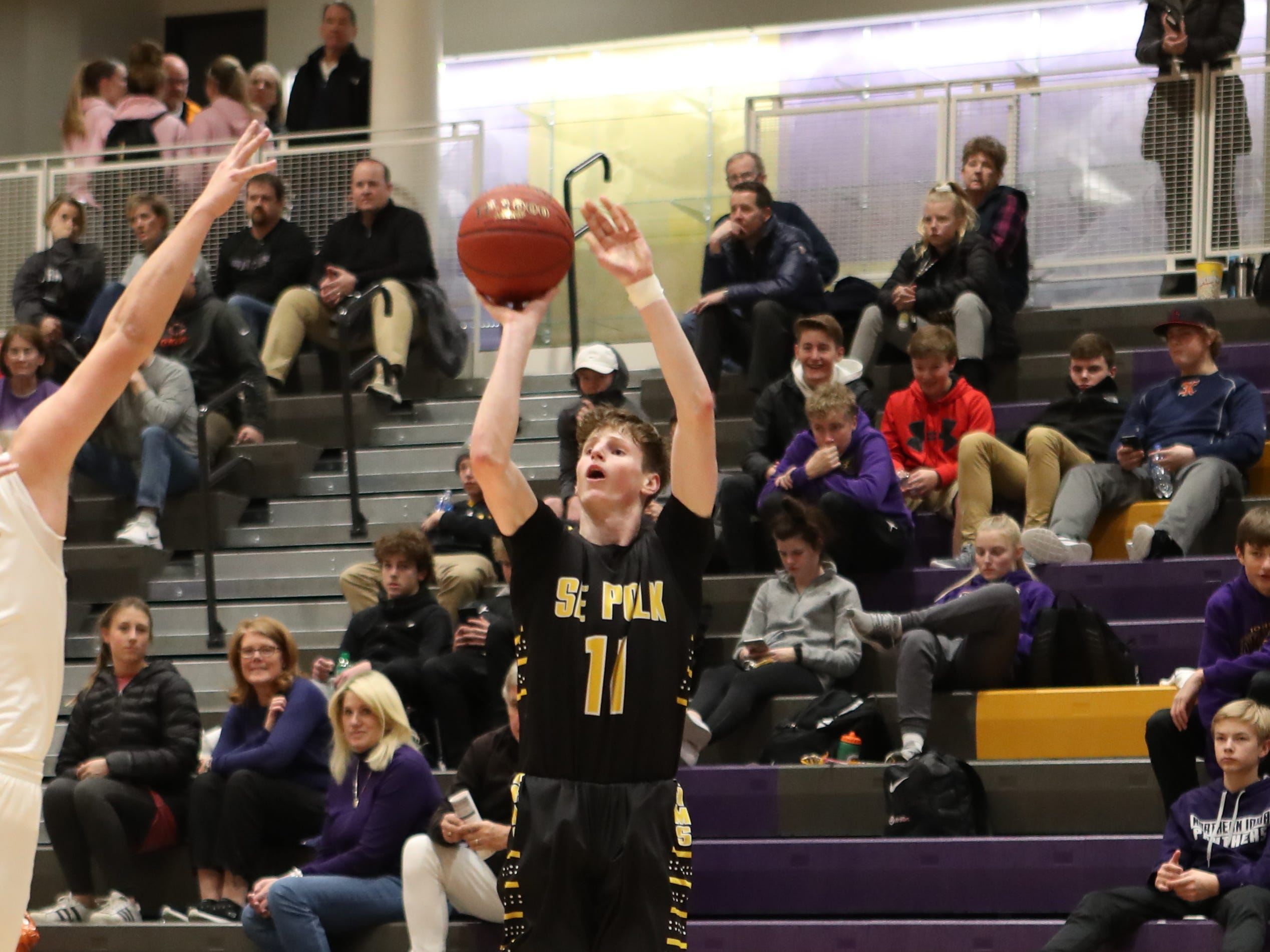 Southeast Polk's Sam Glenn (11) shoots from the outside in a Feb. 5 game at Johnston High School. Johnston won the game 51-44.
