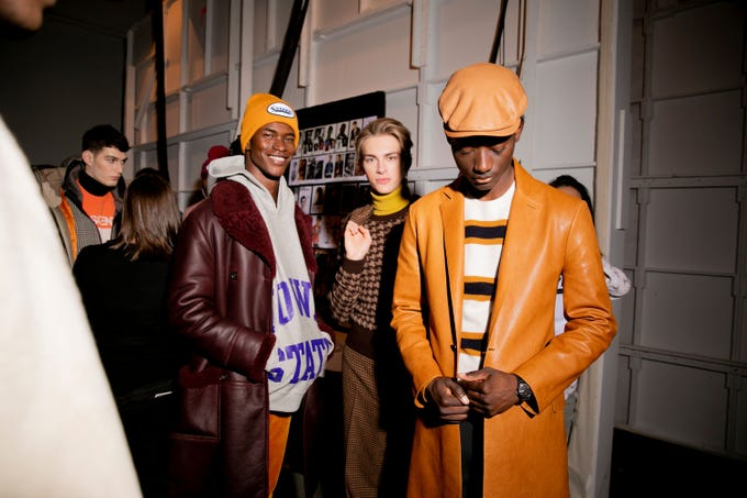 Menswear designer Todd Snyder showed Iowa State hoodies at his Iowa-inspired show, which kicked off New York Fashion week on Feb. 4, 2019. The show's set and menu were a nod to Des Moines bar The High Life Lounge. Photo by Kevin Tachman.