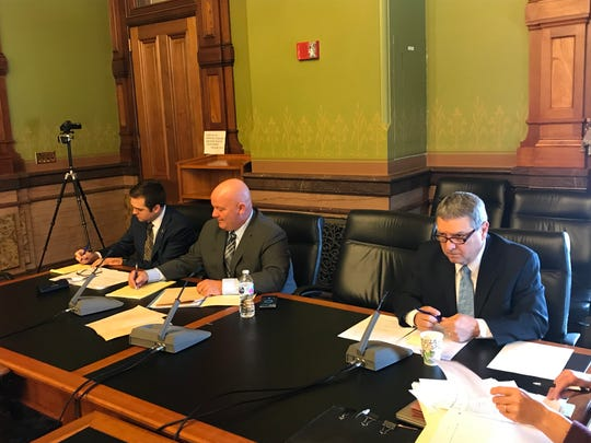 Senators Zach Whiting (left), Jason Schultz and Tony Bisignano consider a bill that would no longer require Iowans to obtain a permit to carry firearms.