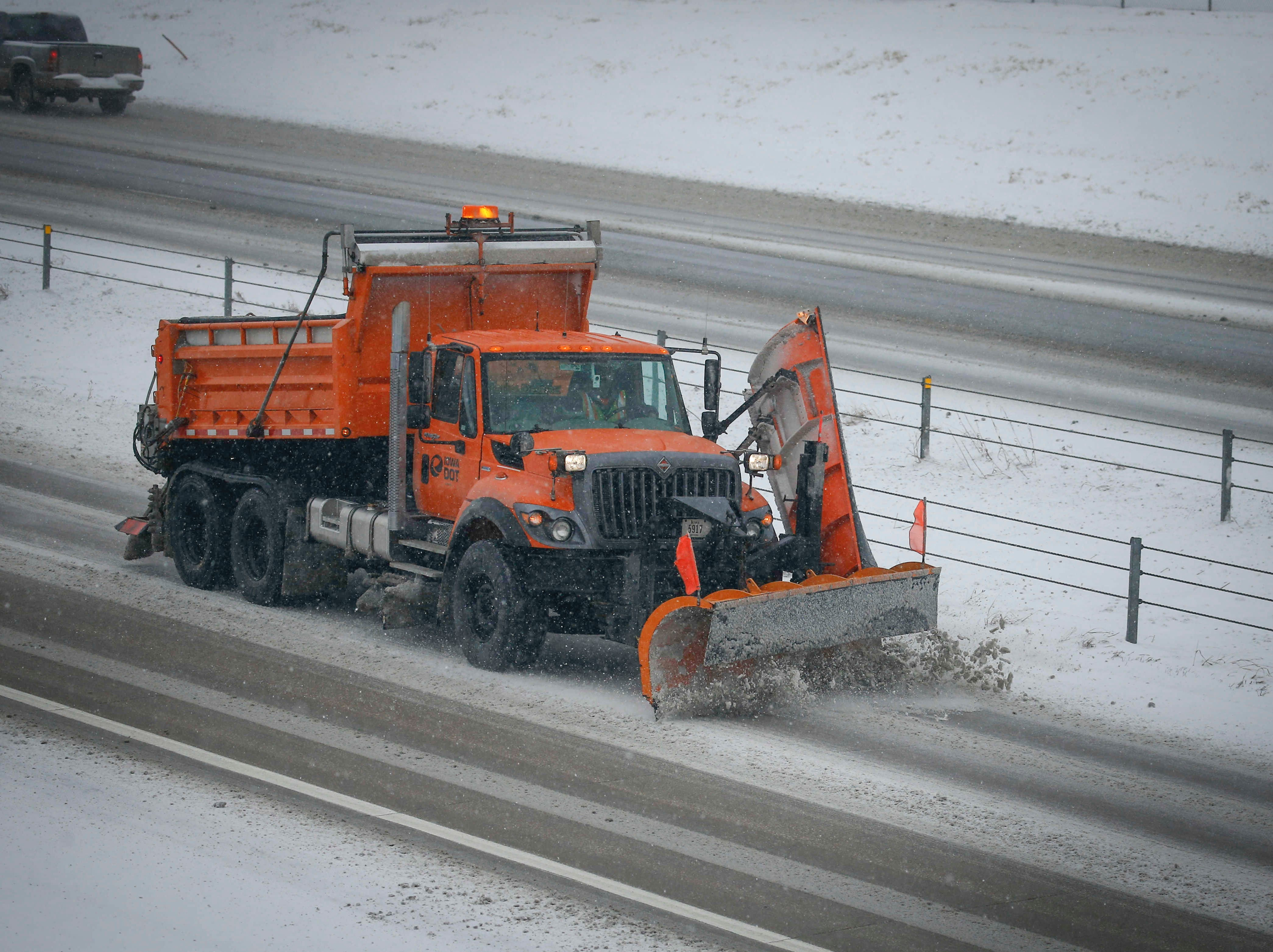 An Iowa Department of Transportation snow plow clears snow off a westbound lane of Interstate 80 in West Des Moines on Monday, Feb. 11, 2019.