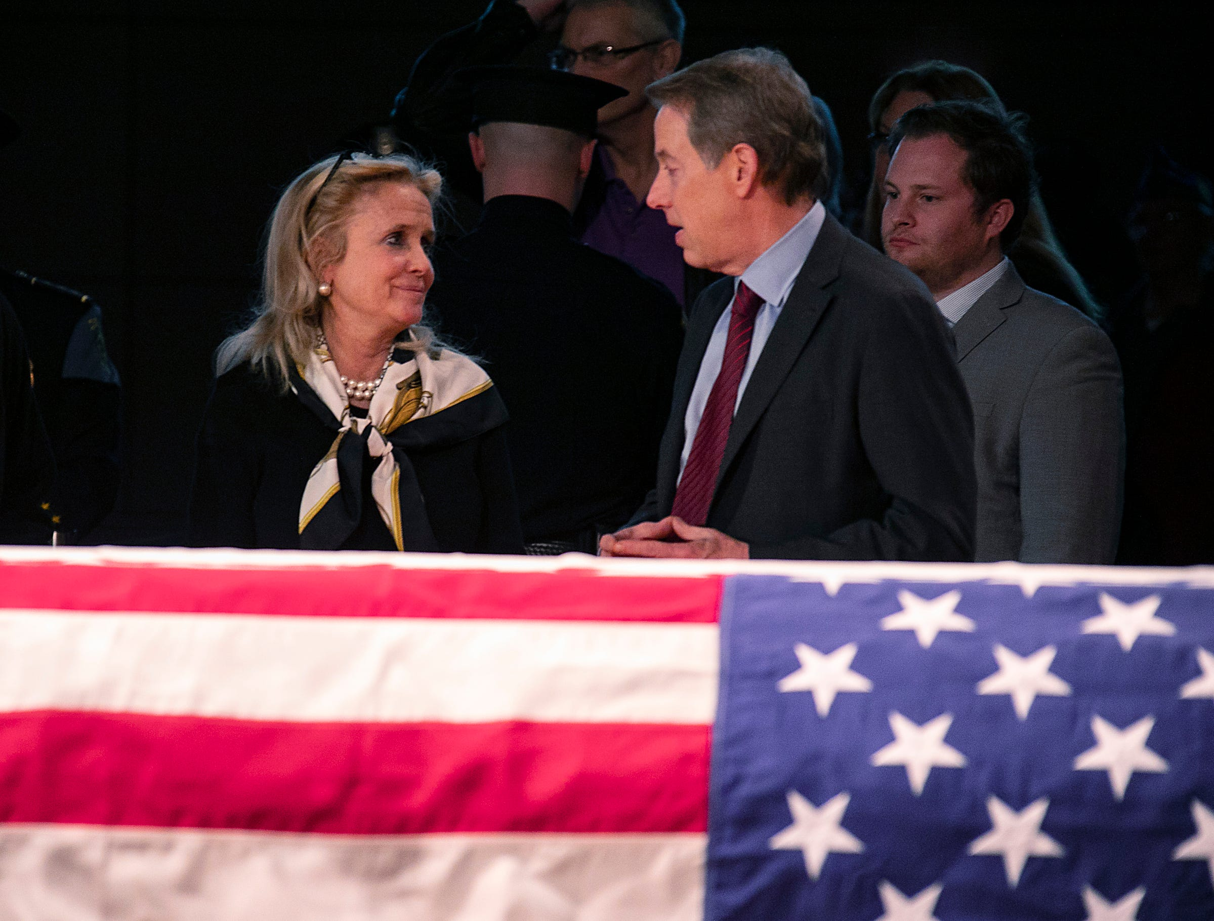 Congresswoman Debbie Dingell greets Bill Ford Jr. as visitors stream by to pay their respects to her husband, John Dingell, during visitation at the Michael A. Guido theater in Dearborn Monday, Feb. 11, 2019.
