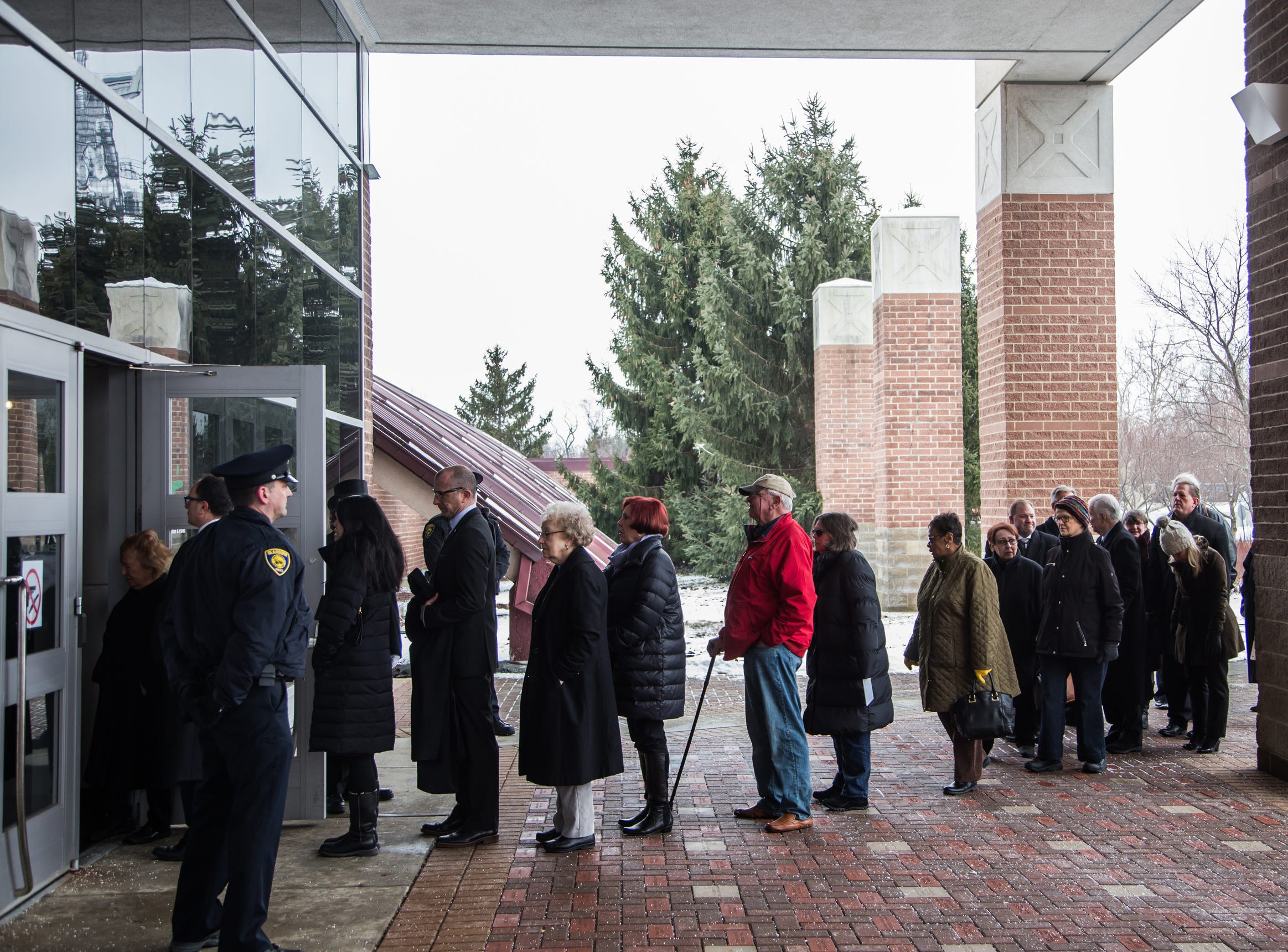 People gather to pay their respects during the visitation for the former US Representative John D. Dingell at the Ford Community and Performing Arts Center in Dearborn on Monday, February 11, 2019.