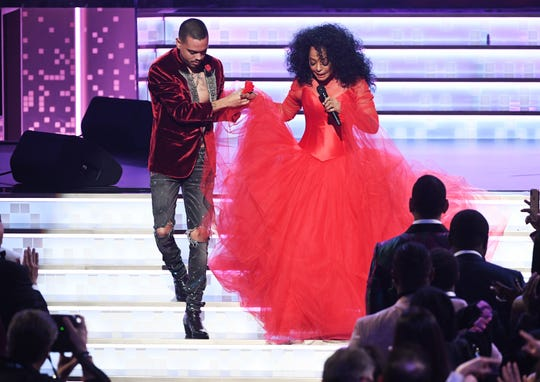 Evan Ross (left) escorts Diana Ross while she performs at the Grammy Awards on Feb. 10, 2019, in Los Angeles.