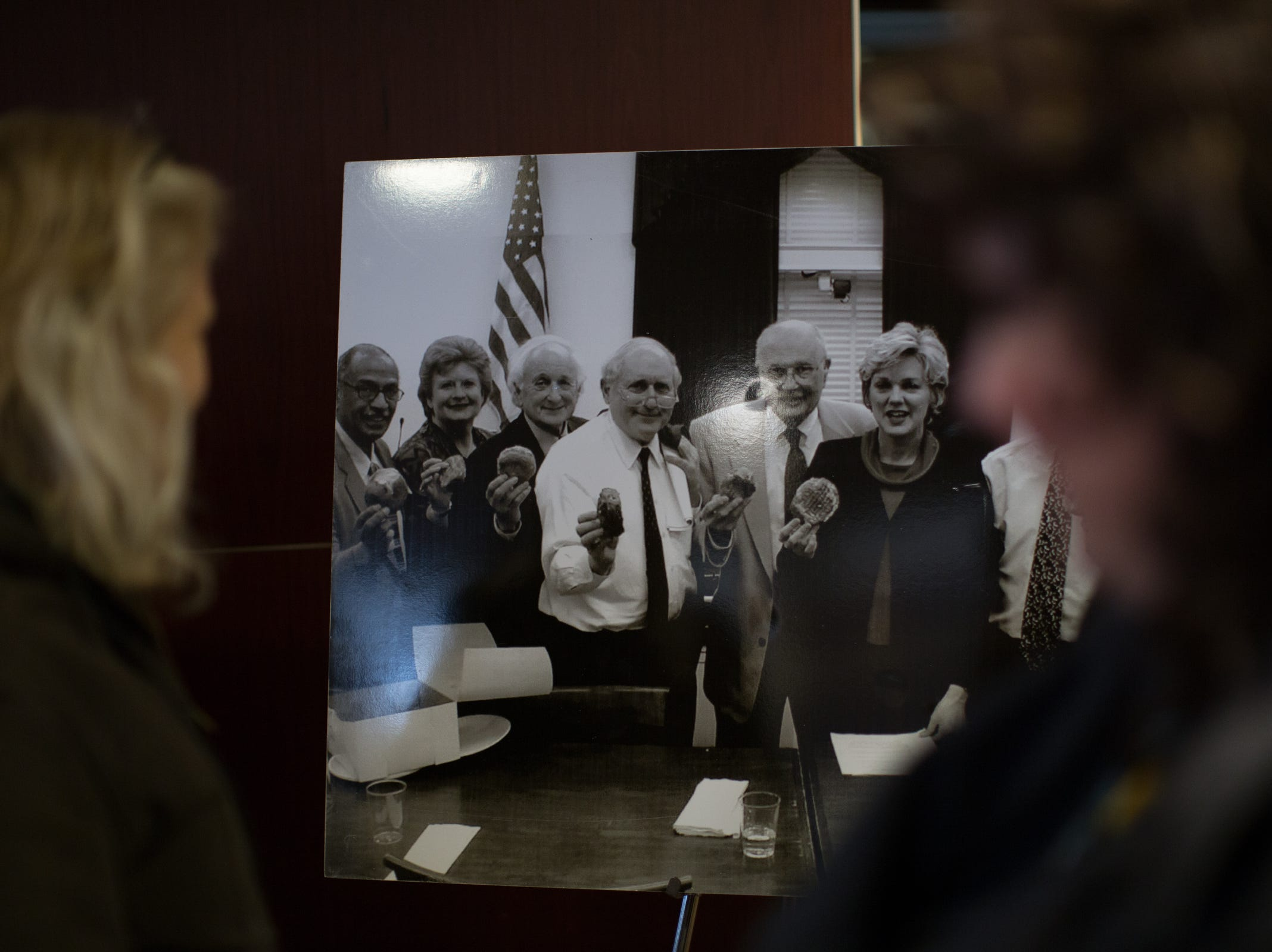 People look over old photos after paying their respects during the visitation for the former U.S. Rep. John D. Dingell at the Ford Community and Performing Arts Center in Dearborn on Monday, February 11, 2019.