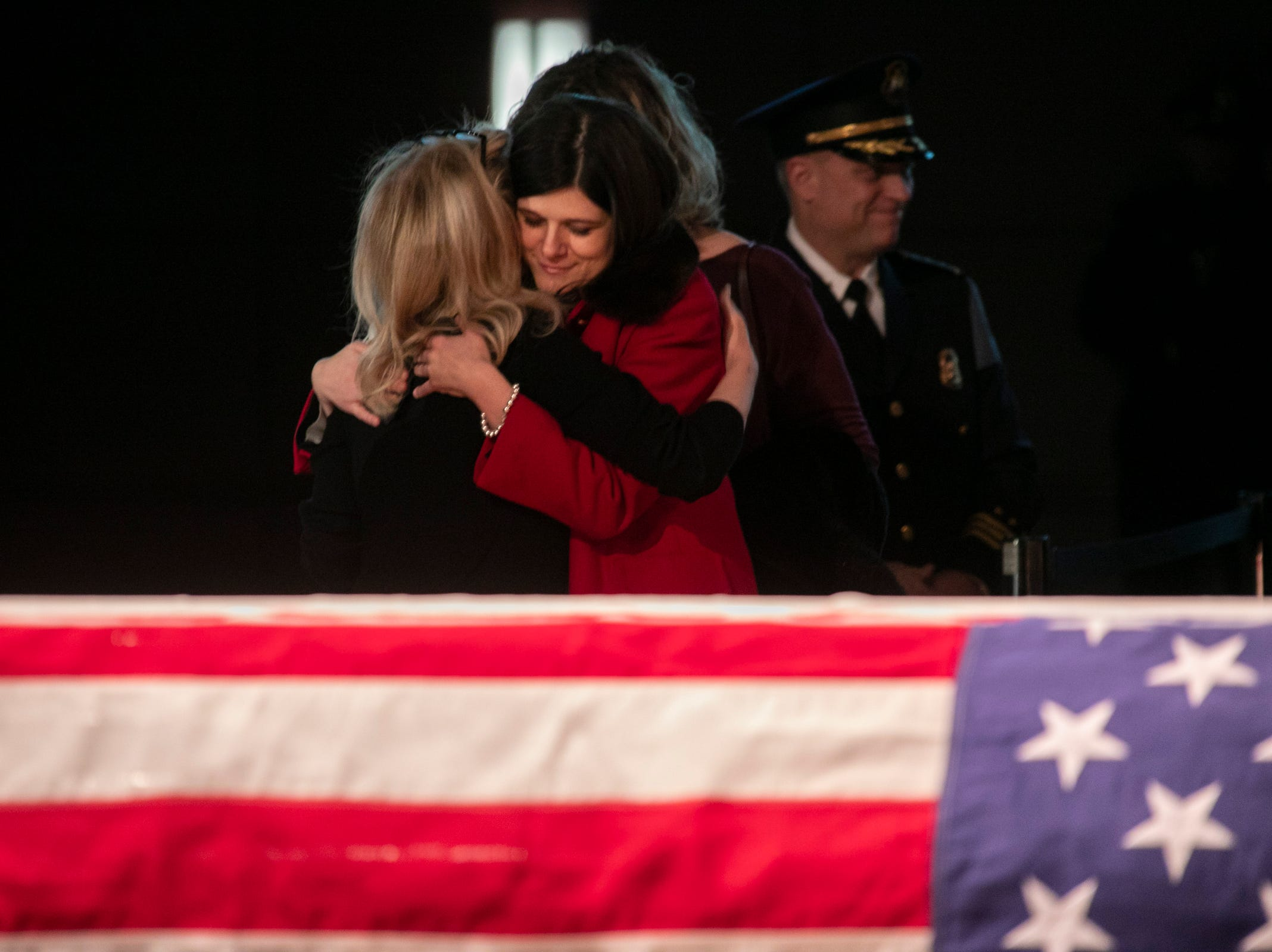 Congresswoman Debbie Dingell greets Rep. Haley Stevens as visitors stream by to pay their respects to her husband John Dingell who is lying in repose at the Michael A. Guido theater in Dearborn Monday, Feb. 11, 2019.