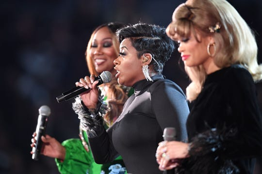 From right: Andra Day, Fantasia and Yolanda Adams perform an Aretha Franklin tribute during the 61st Grammy Awards on Feb. 10, 2019, in Los Angeles.