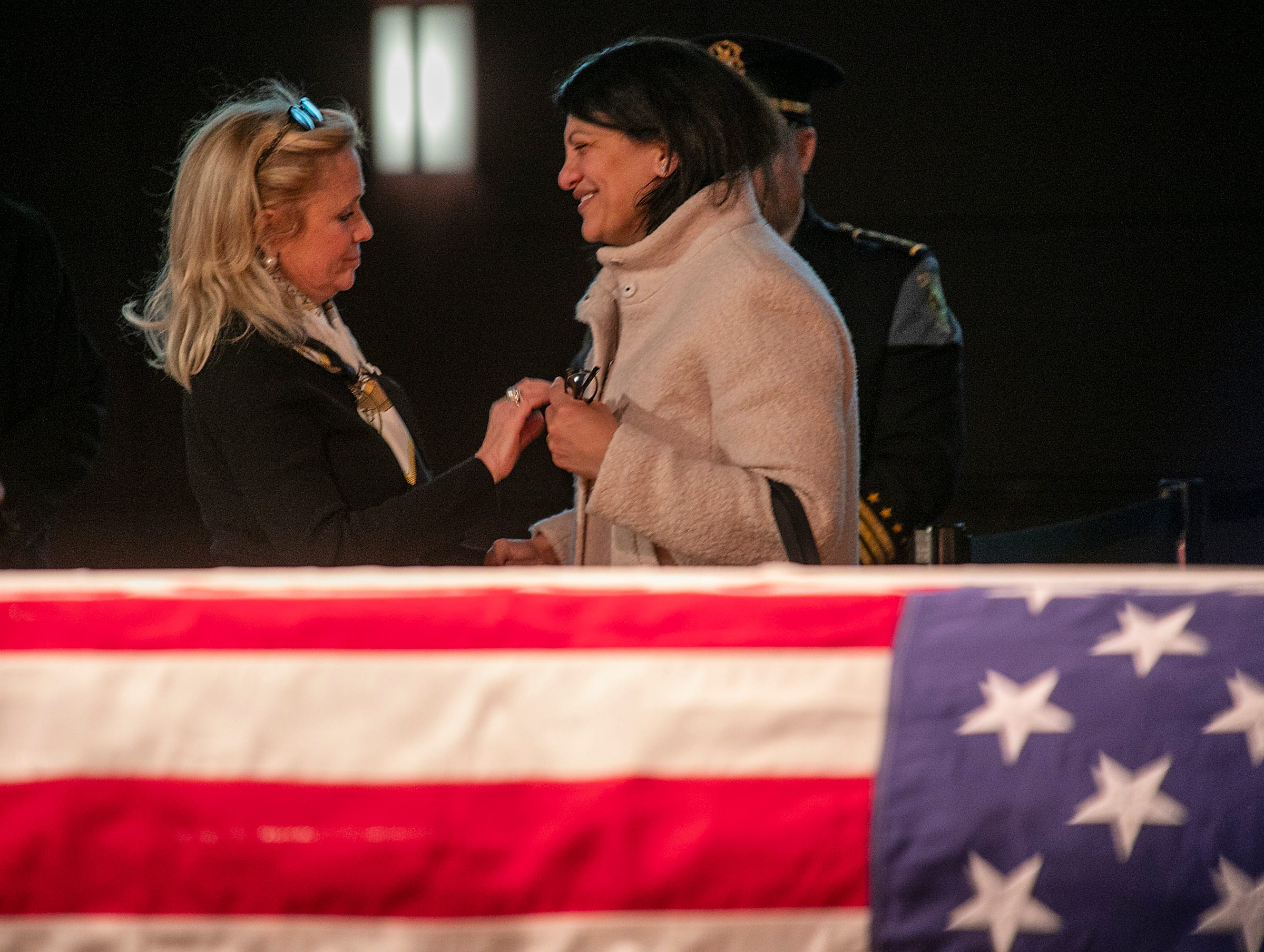 Congresswoman Debbie Dingell, left, greets congresswoman Rashida Tlaib as visitor stream by to pay their respects to her husband John Dingell who is lying in repose at the Michael A. Guido theater in Dearborn Monday, Feb. 11, 2019.