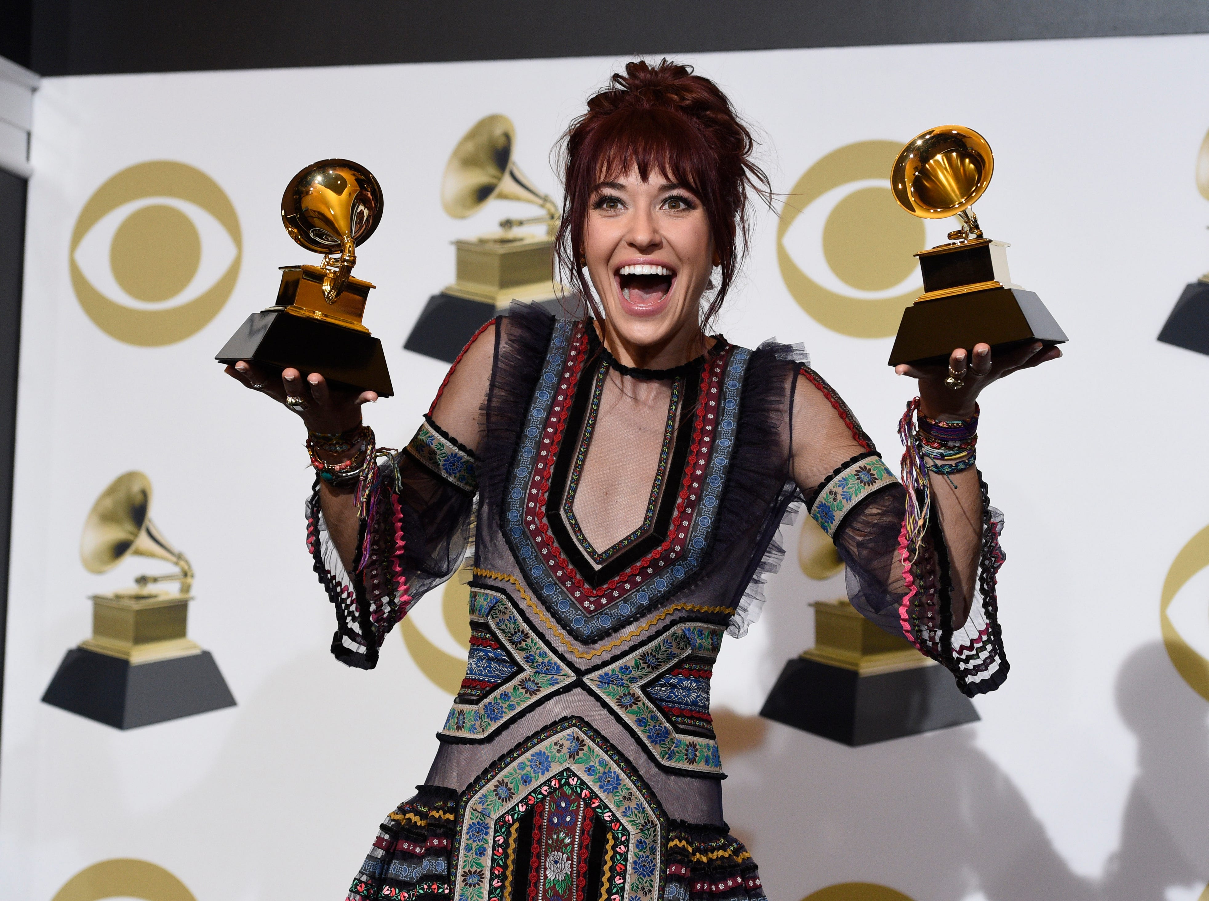 "Laura Daigle poses in the press room with the awards for best contemporary christian music performance/song for ""You Say"" and best contemporary christian music album for ""Look Up Child"" at the 61st annual Grammy Awards."
