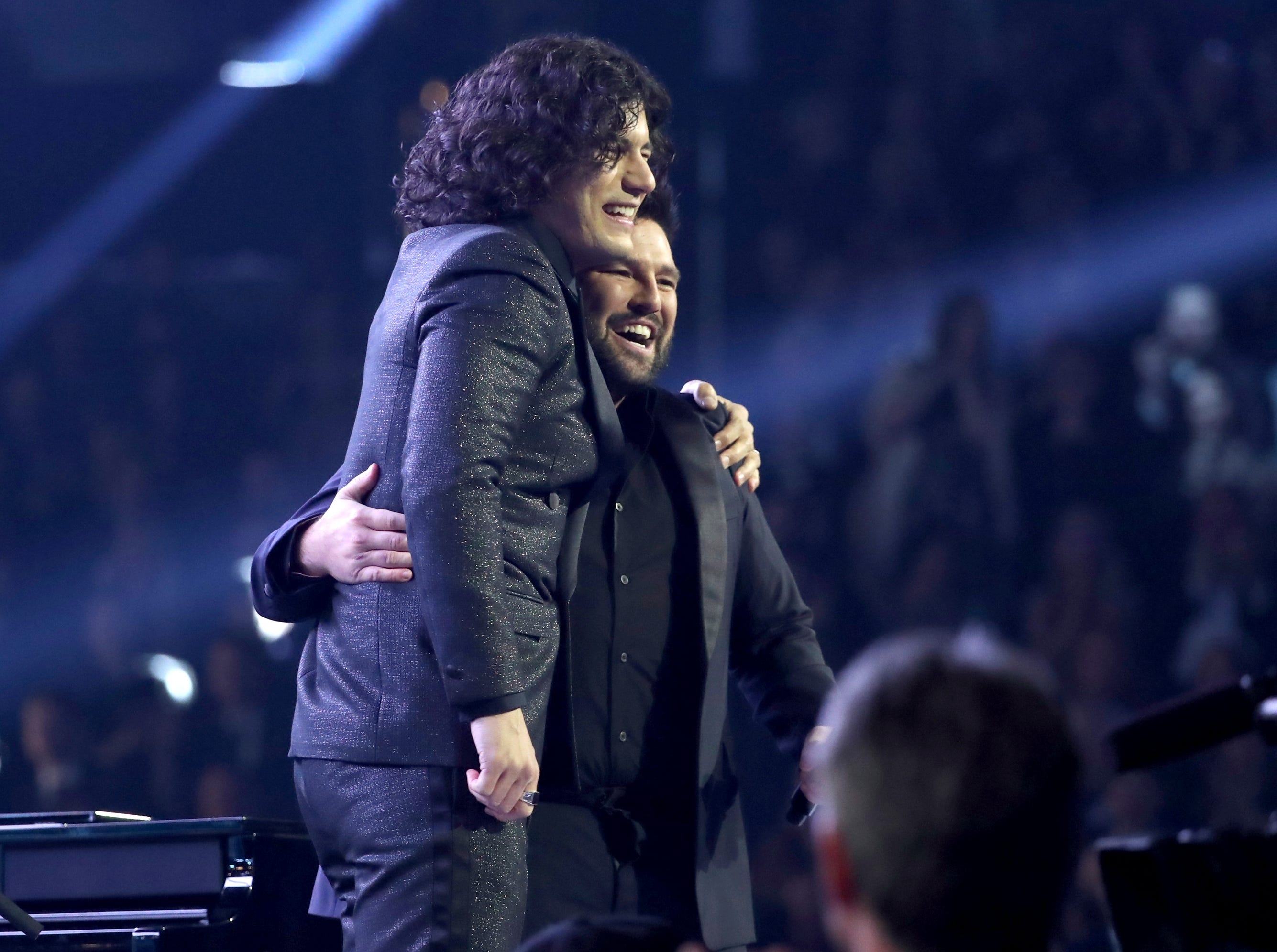 "Dan Smyers, left, and Shay Mooney, of Dan + Shay, embrace after performing ""Tequila"" at the 61st annual Grammy Awards."
