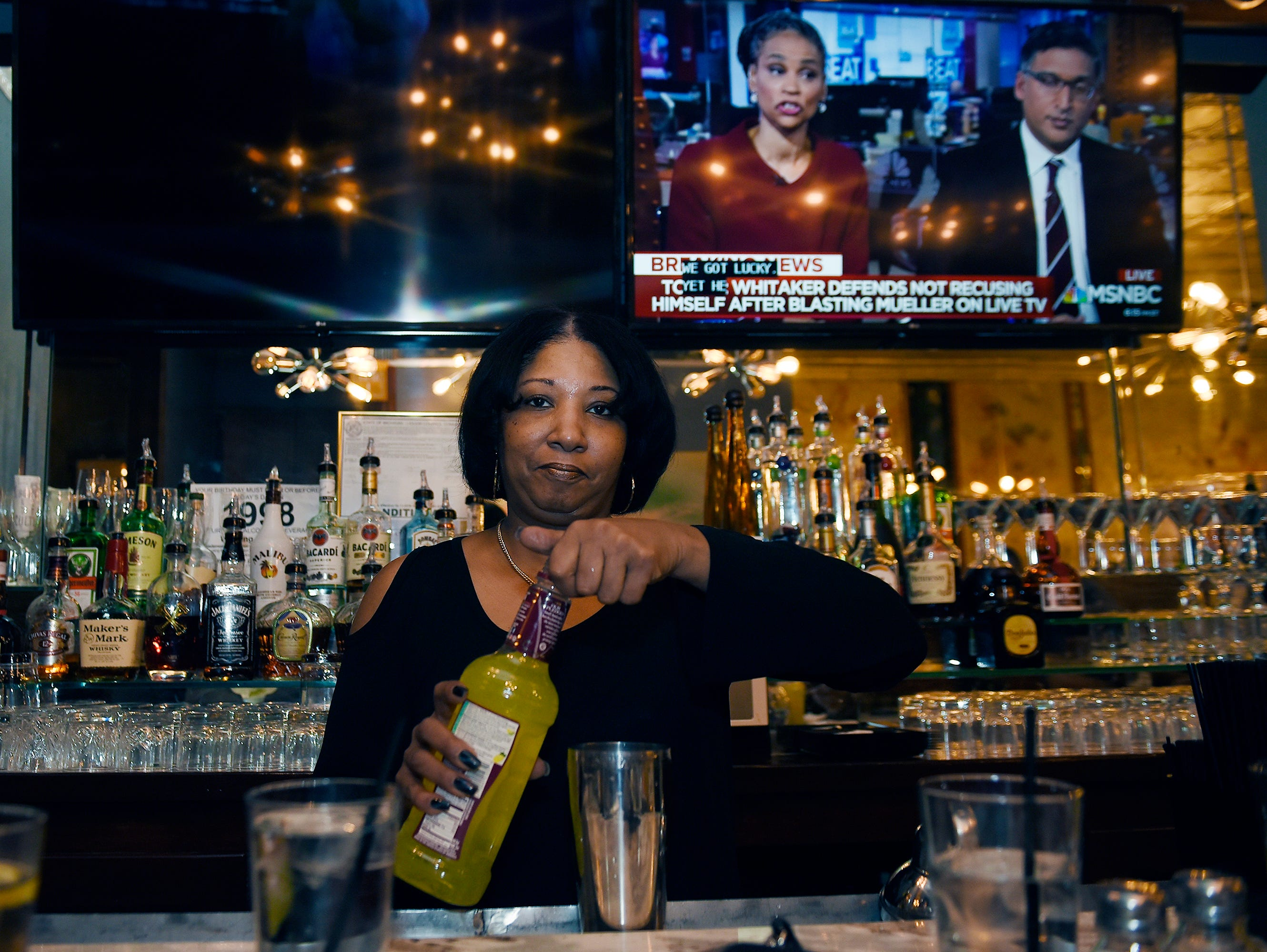 Mechelle Young, bartender, prepares a drink.